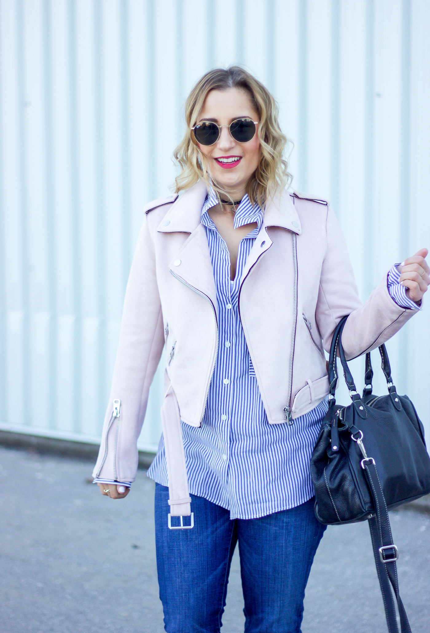 Canadian life and style blogger, Jackie Goldhar of Something About That, shows how to wear a pastel pink jacket for spring