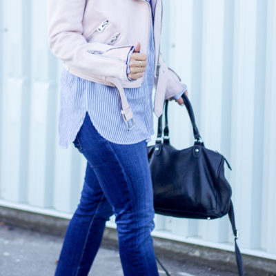 Canadian fashion blogger, Jackie Goldhar from Something About That, shares how to wear a pastel pink suede jacket with jeans and a striped blouse