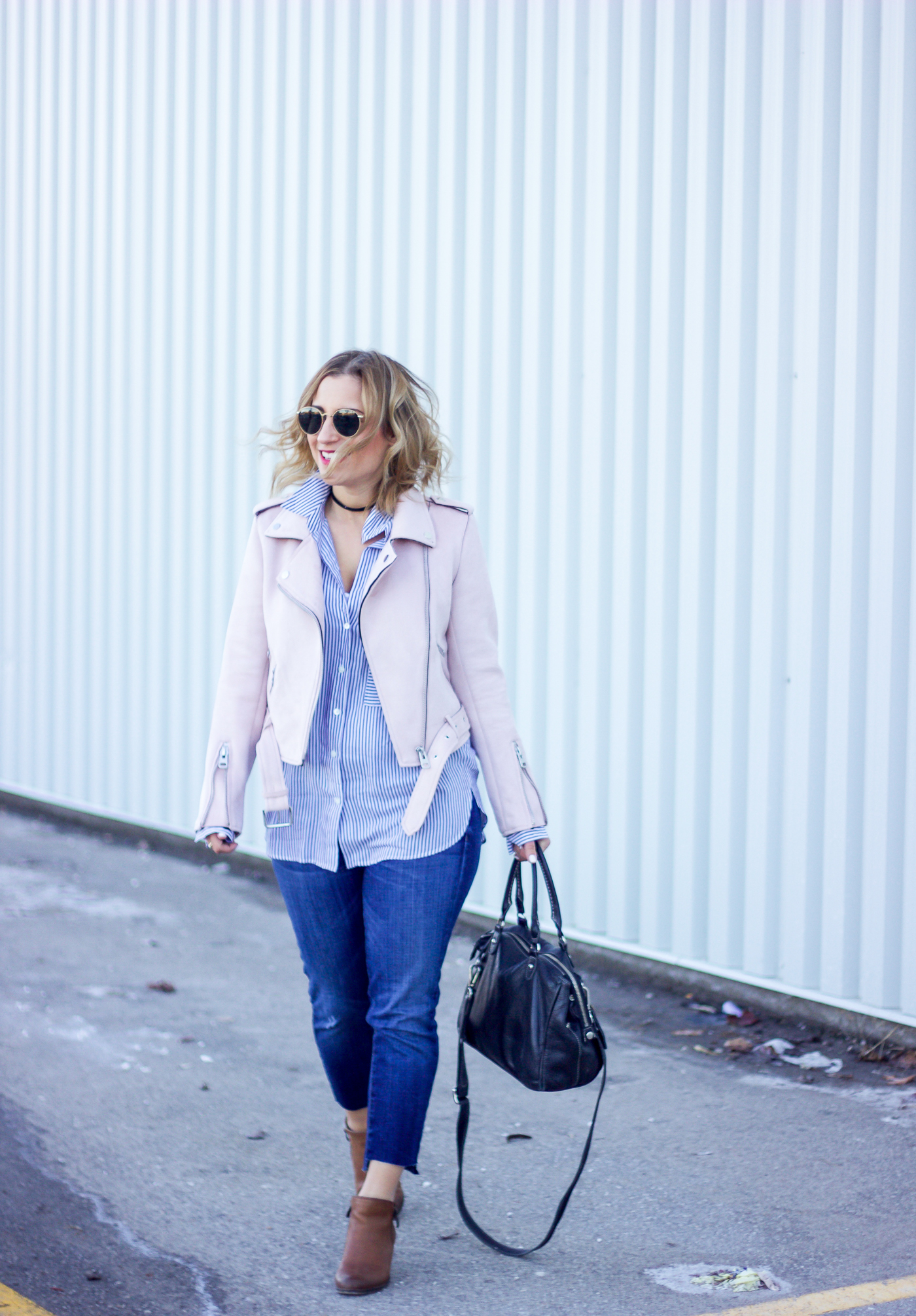 Toronto fashion, beauty and lifestyle blogger, Jackie Goldhar of Something About That is wearing a pink moto jacket from Zara and Current Elliott jeans for spring