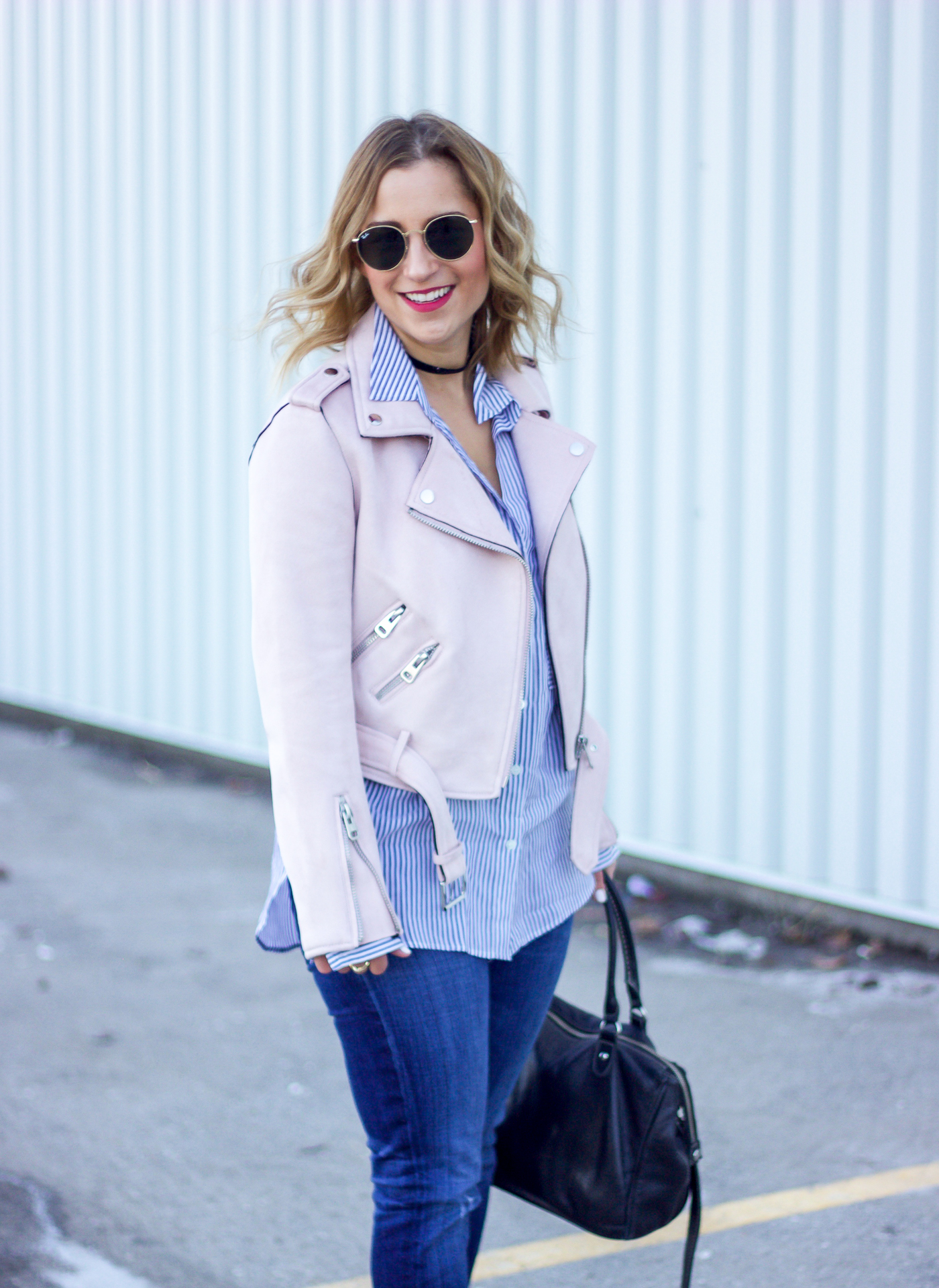 How to wear a pink motorcycle jacket, as seen on a fashion blogger