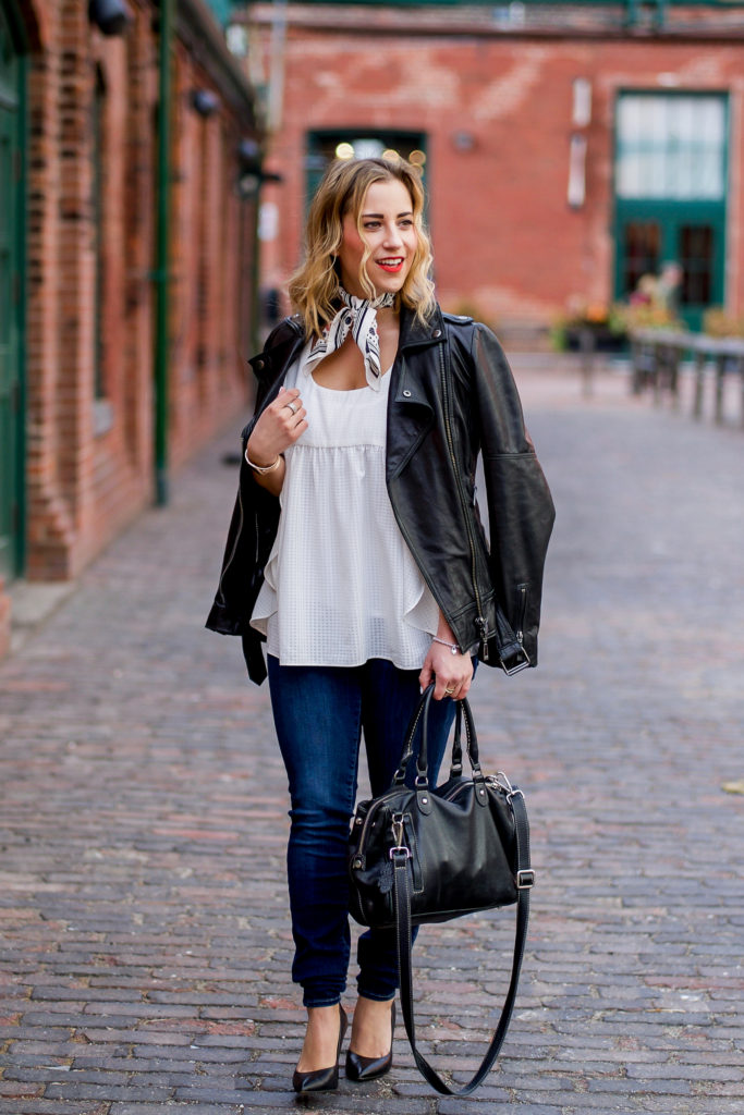 Toronto fashion and lifestyle blogger is wearing a Soia and Kyo black leather motorcycle jacket with a white top from Target, Fidelity skinny jeans and black Vince Camuto pumps