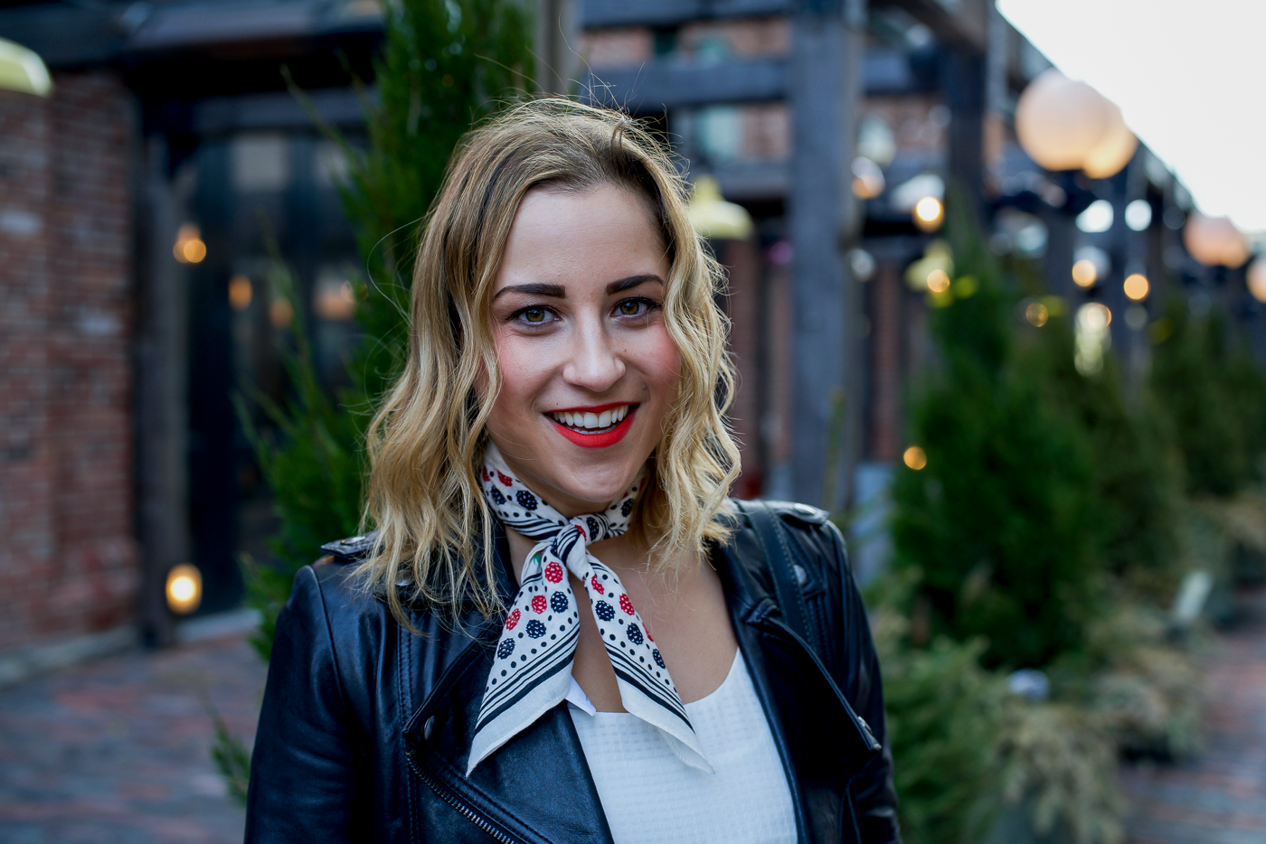 Toronto fashion and lifestyle blogger, Jackie of Something About That, wearing an edgy weekend outfit, with a black leather jacket and printed neck scarf from J.Crew
