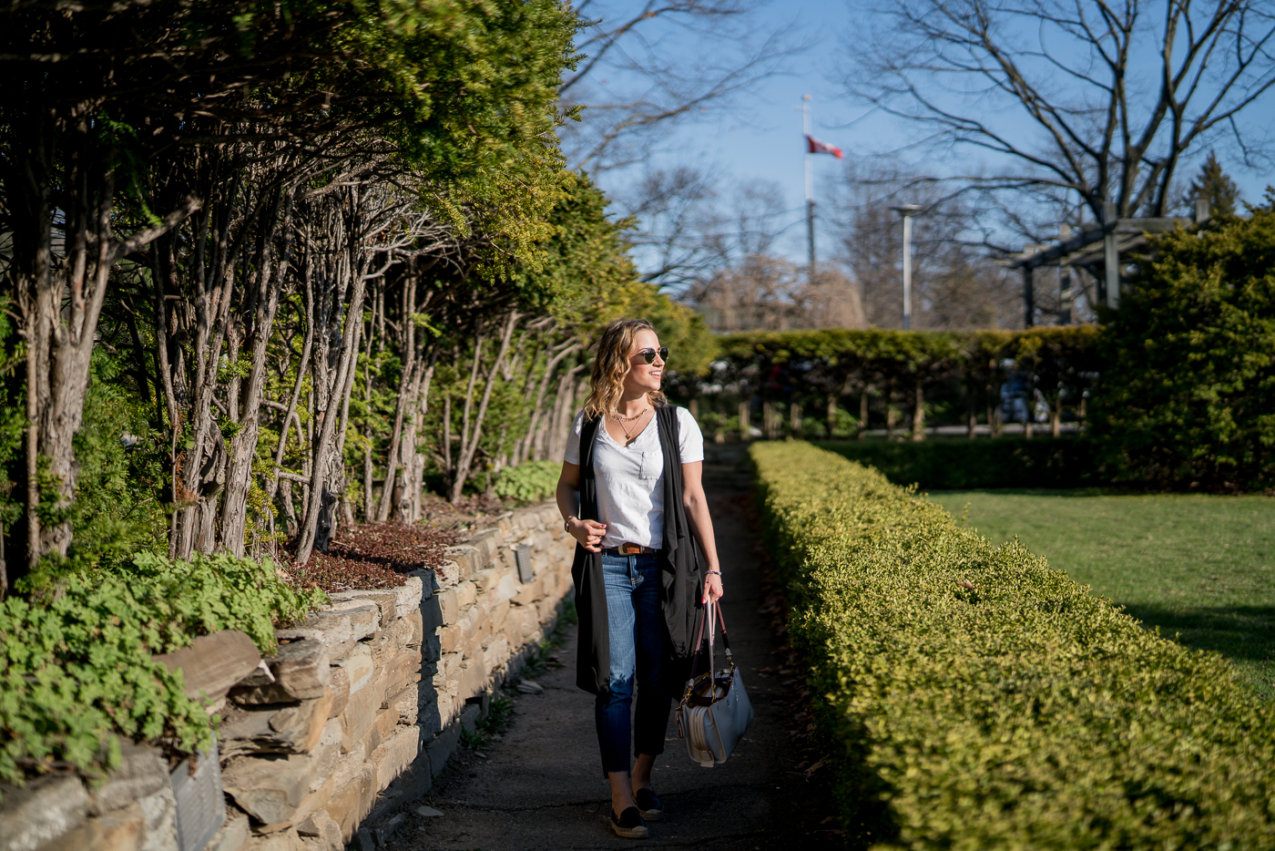 Spring in Toronto's High Park, with blogger Jackie of Something About That in a black vest and white t-shirt