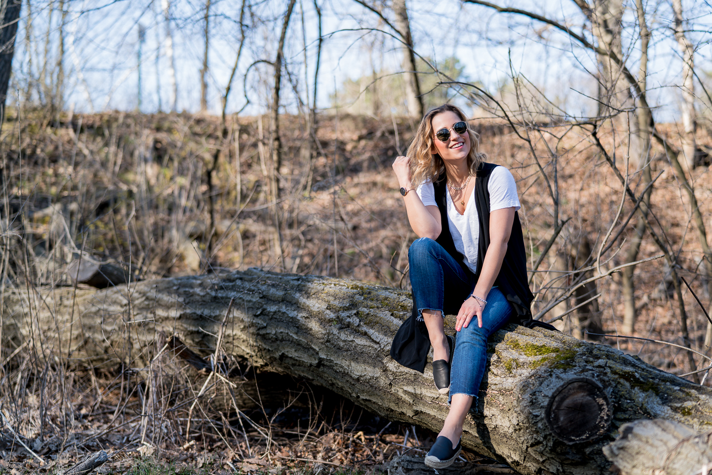 Toronto fashion blogger is wearing the black Jared vest from Luved Clothing