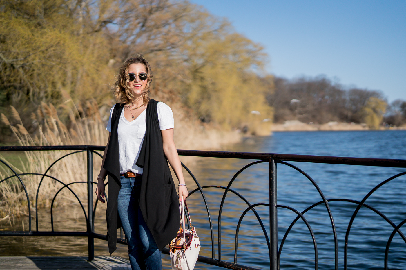 Top Canadian fashion and lifestyle blogger is sharing a spring outfit idea, featuring a vest from Luved Clothing