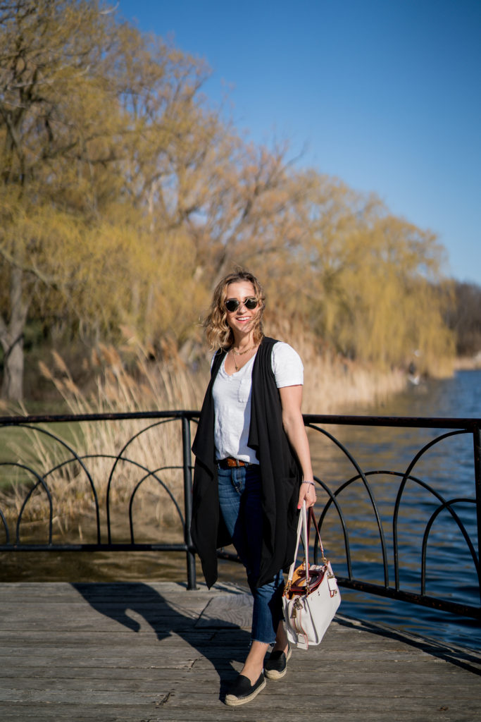 Toronto fashion and lifestyle blogger, Jackie of Something About That, wearing a Luved Clothing Jared Vest in black with jeans