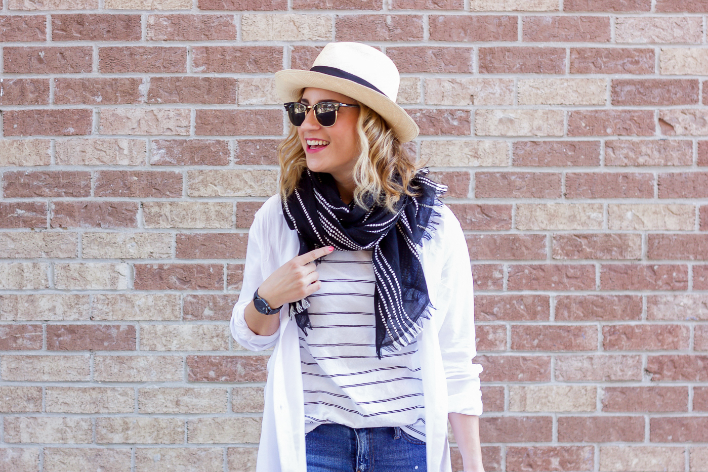 Jackie Goldhar is a Toronto-based fashion blogger, wearing a white button down top from Aritzia with a black and white striped scarf from Gap