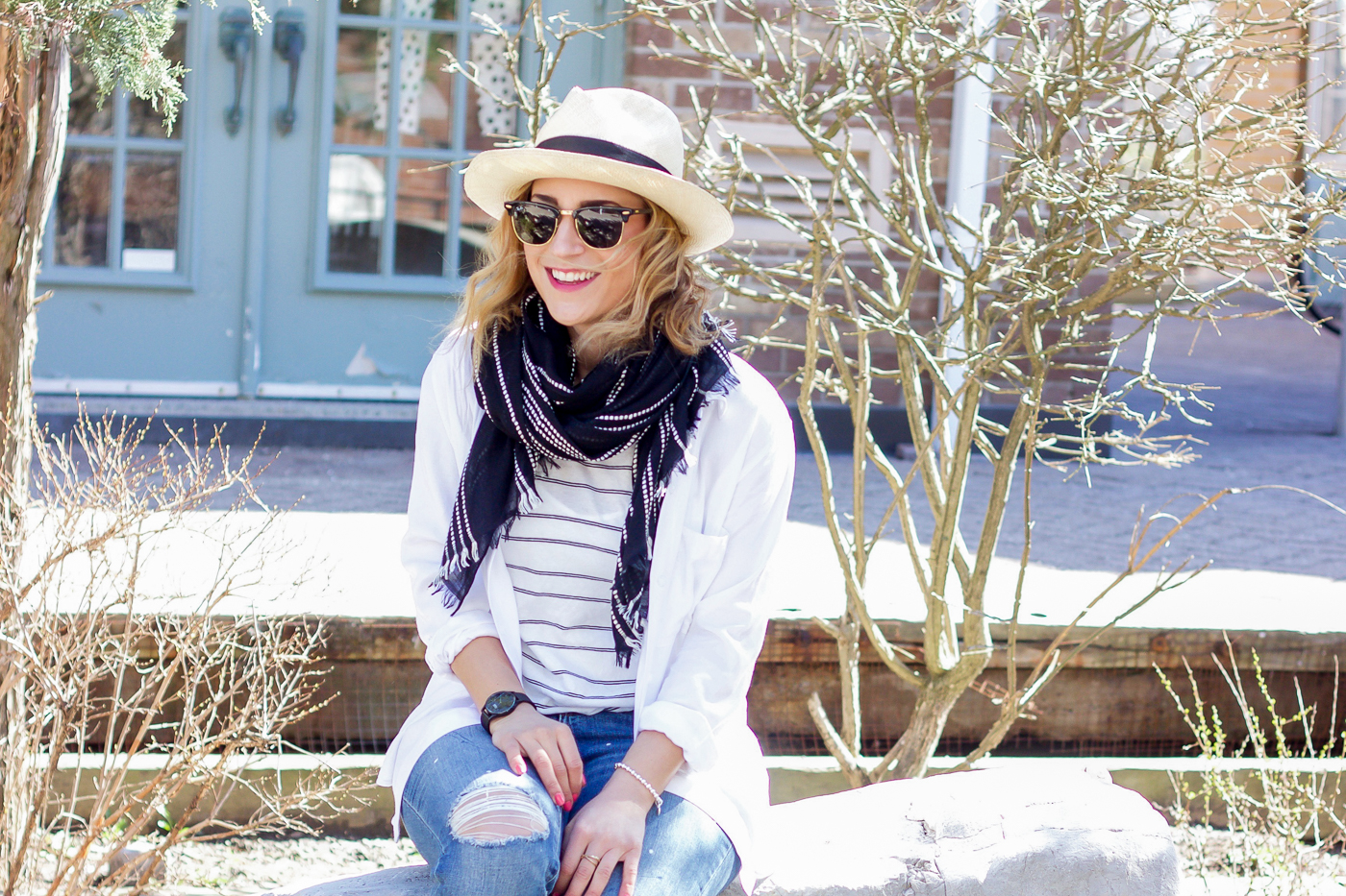 This spring outfit, featuring a white button down from Aritzia, striped tank from Madewell, Gap distressed girlfriend jeans and a black linen scarf is a go-to combo for spring