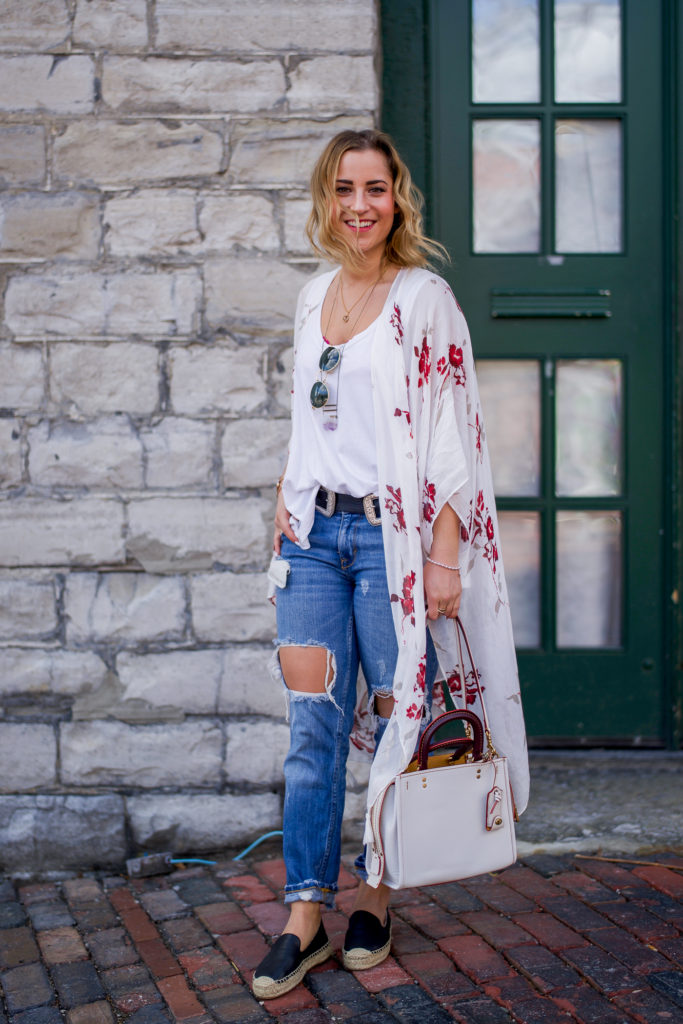 Canadian fashion and lifestyle blogger, Jackie Goldhar, wearing a simple spring outfit, with florals and ripped boyfriend jeans from Zara