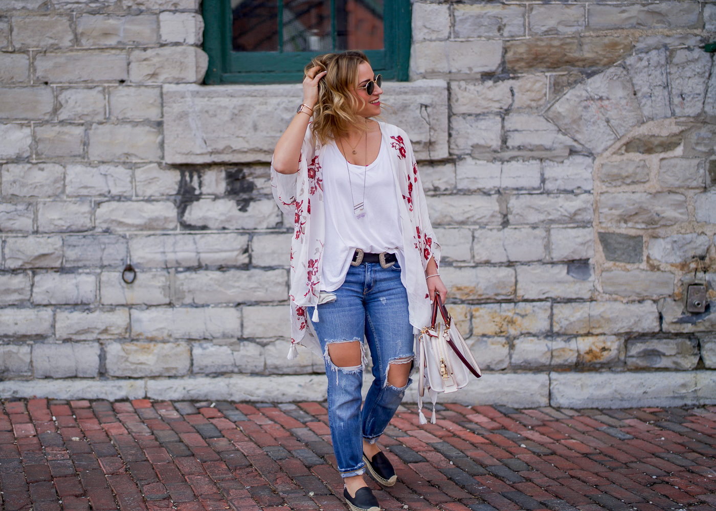 Canadian fashion blogger is wearing a spring outfit with a Gentle Fawn floral kimono