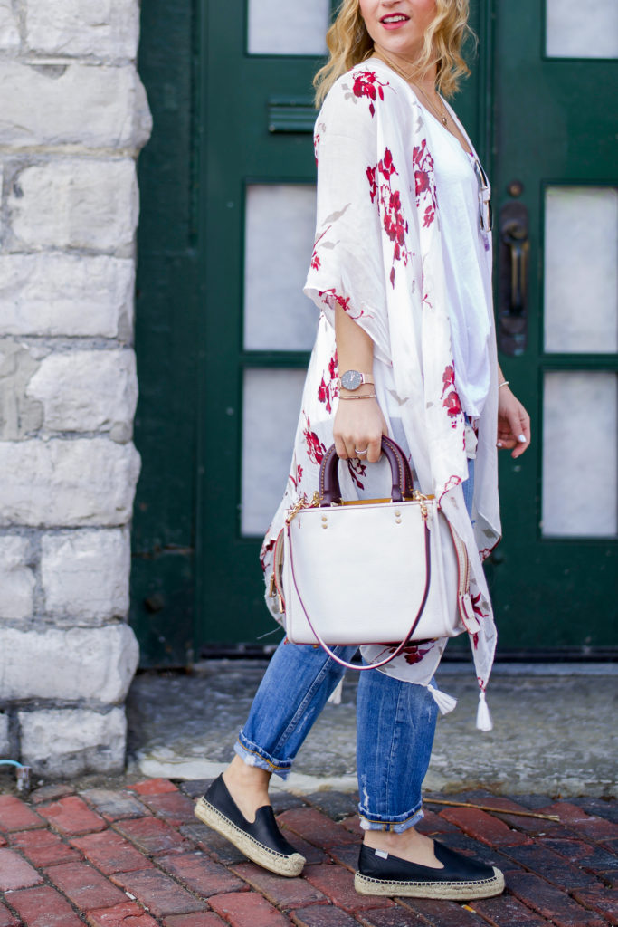 Toronto fashion blogger, wearing spring florals from Gentle Fawn and the Coach ROGUE 25 in glovetanned pebble leather