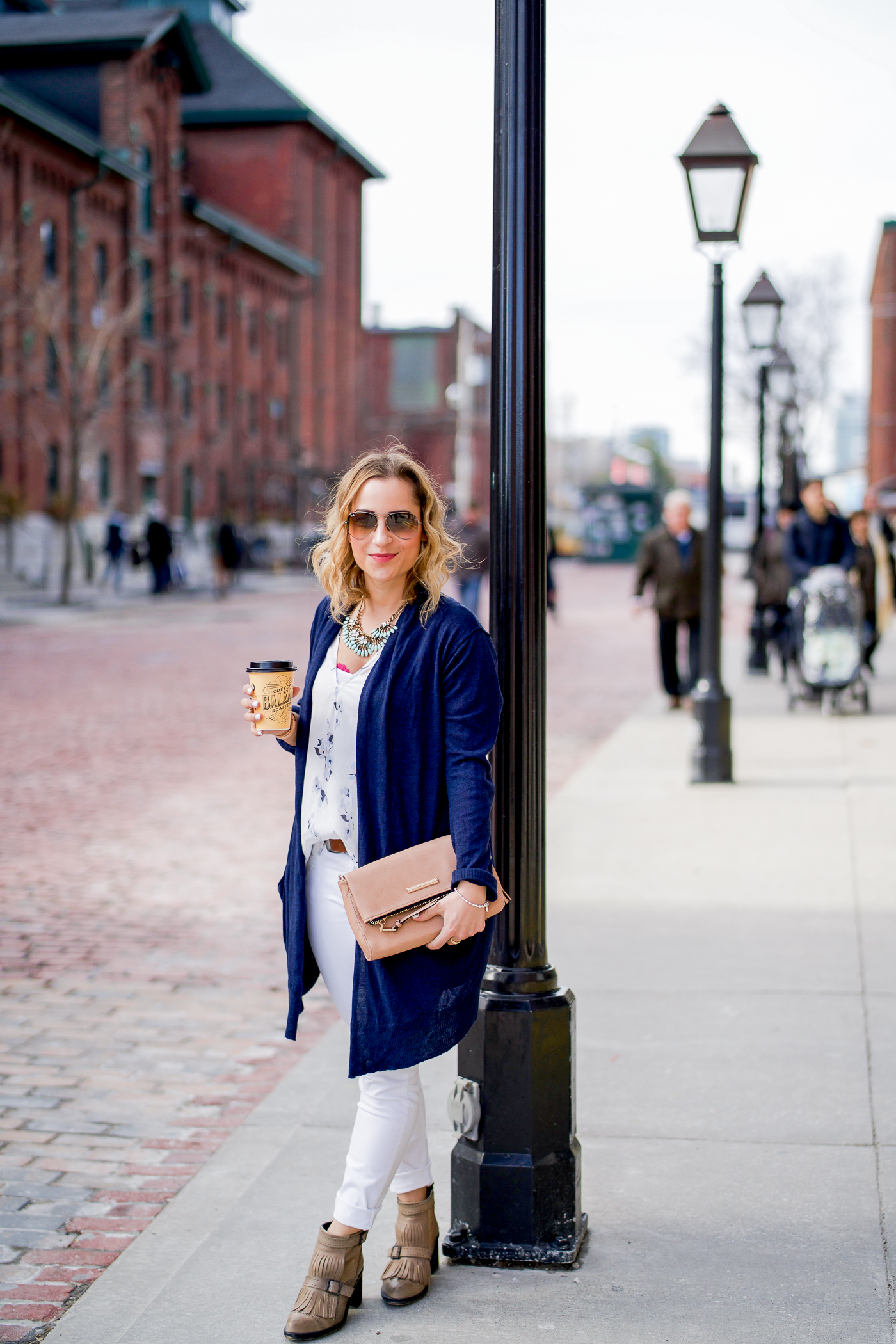 Canadian fashion and lifestyle blogger, Jackie of Something About That, drinking Balzac's Coffee in the Distillery District of Toronto