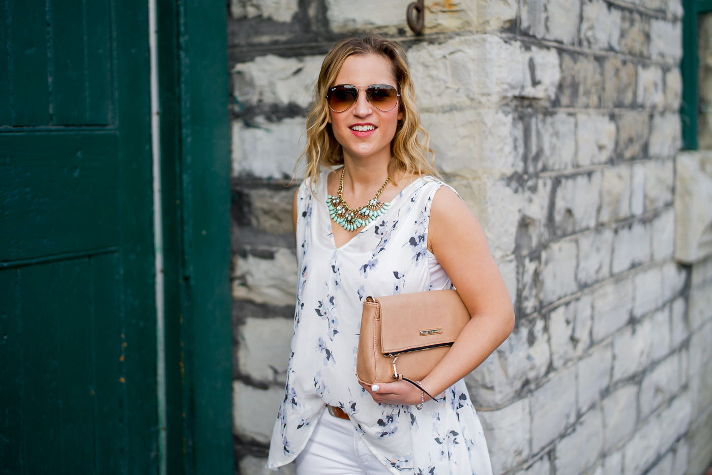 Toronto fashion blogger is wearing a white floral top from Gentle Fawn