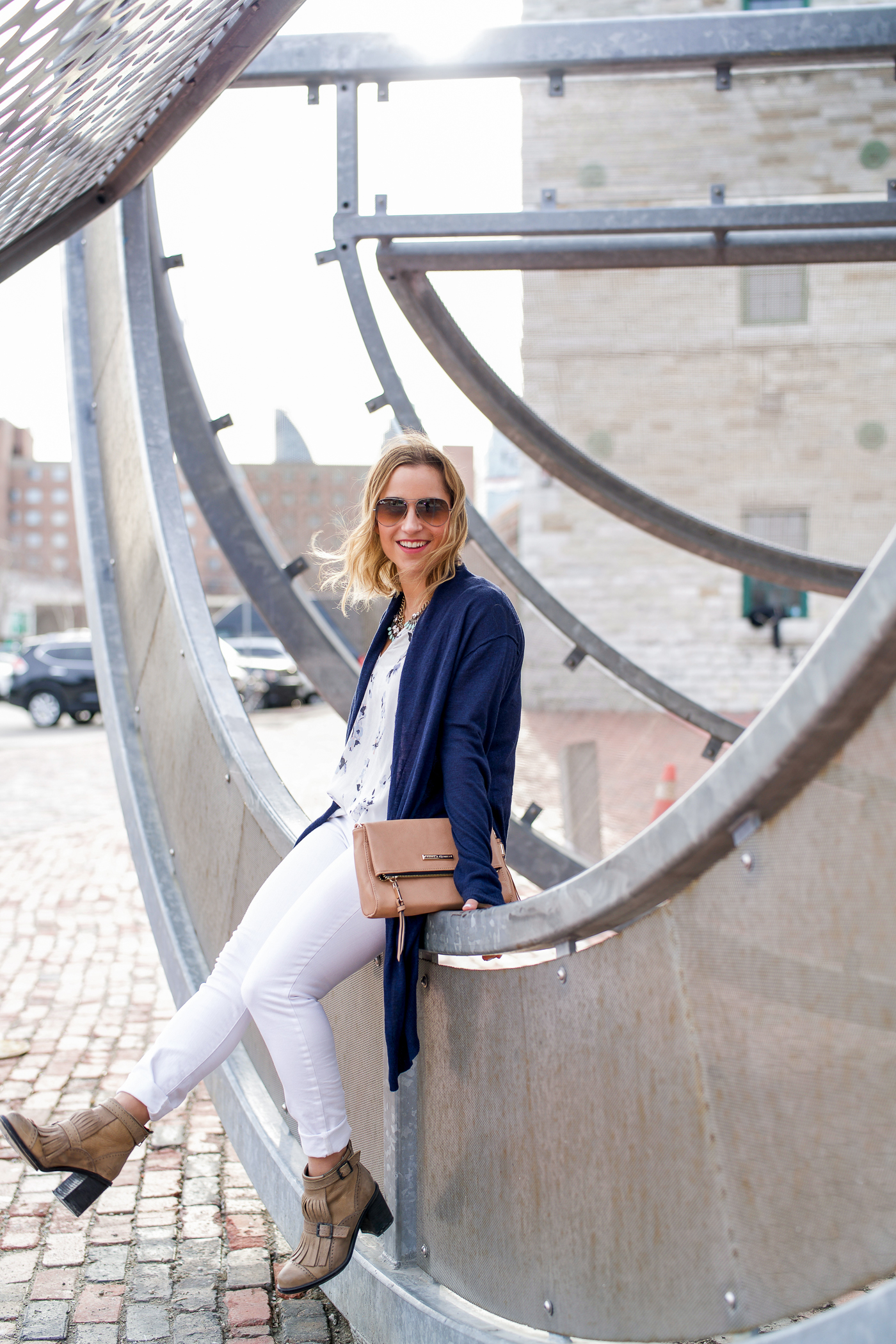 Canadian fashion and lifestyle blogger, Jackie Goldhar of Something About That, is sharing a spring outfit with white jeans and a navy cardigan, that she wore in Toronto's Distillery District