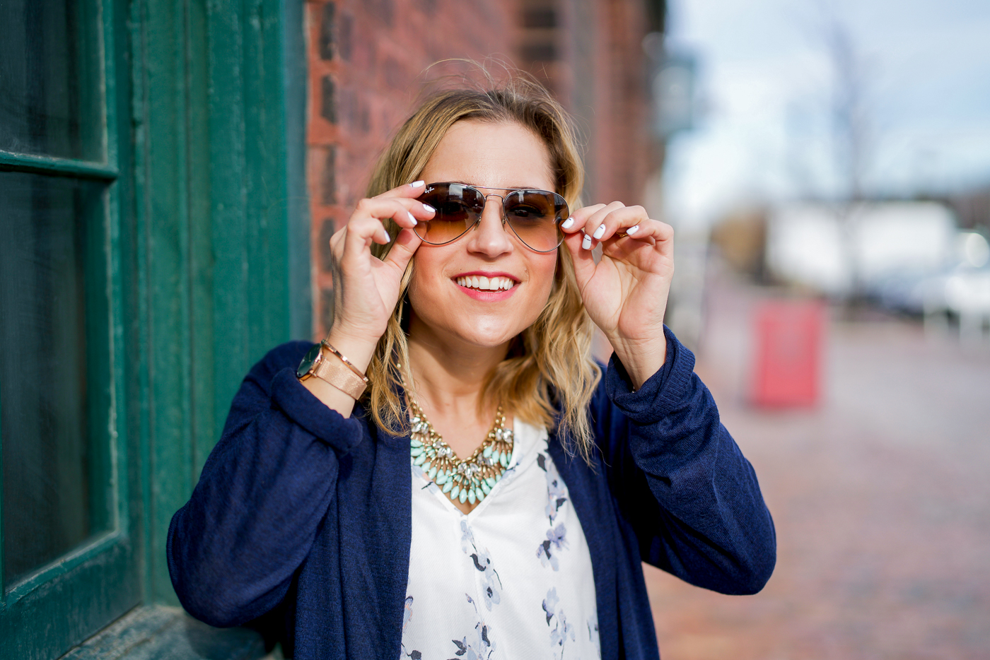Canadian fashion blogger is wearing her signature Ray-Ban Aviator sun glasses with a spring outfit