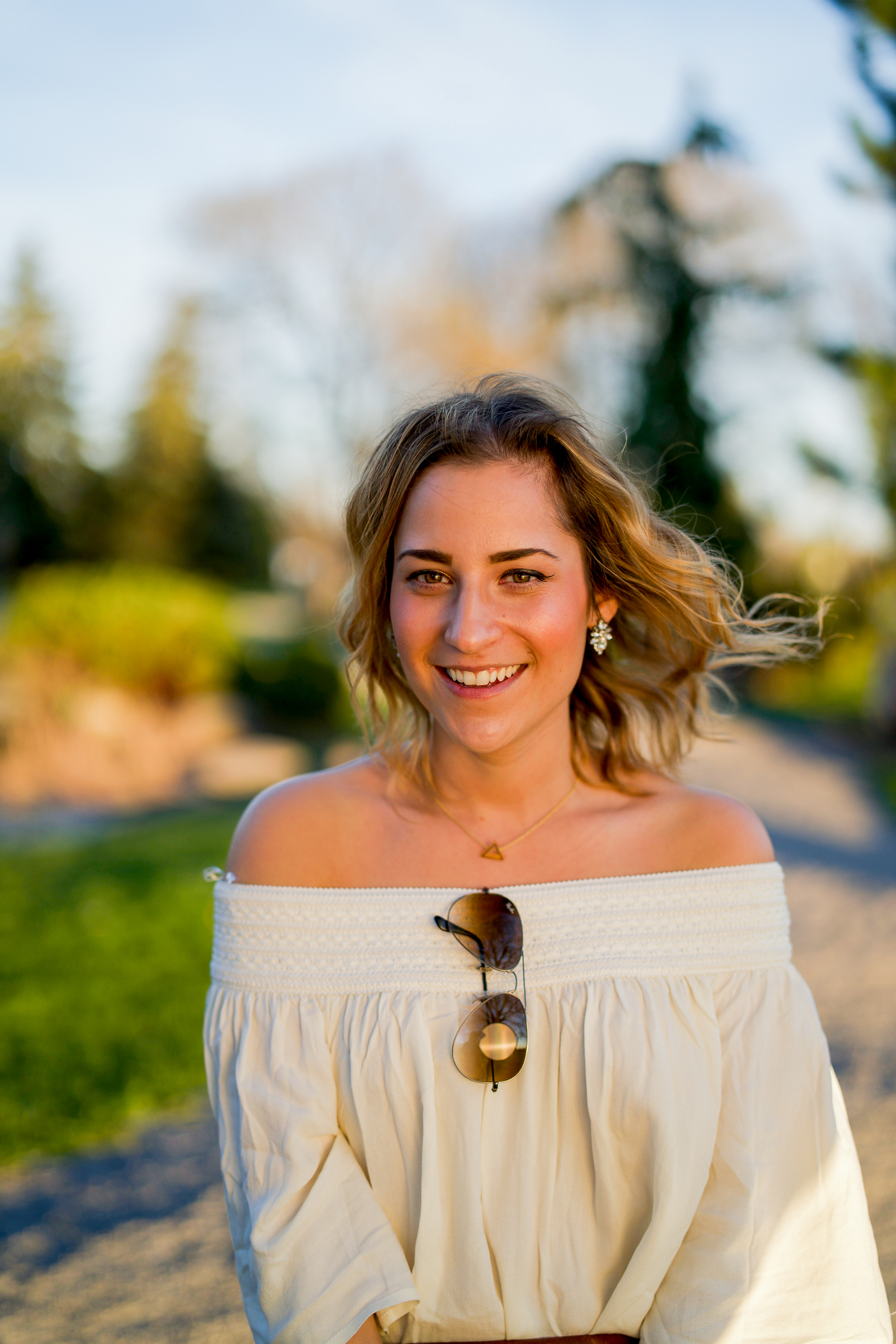Jackie Goldhar is a Toronto fashion and lifestyle blogger, who's wearing an off the shoulder top with jeans because she found a perfect strapless bra at Coup de Foudre in Aurora