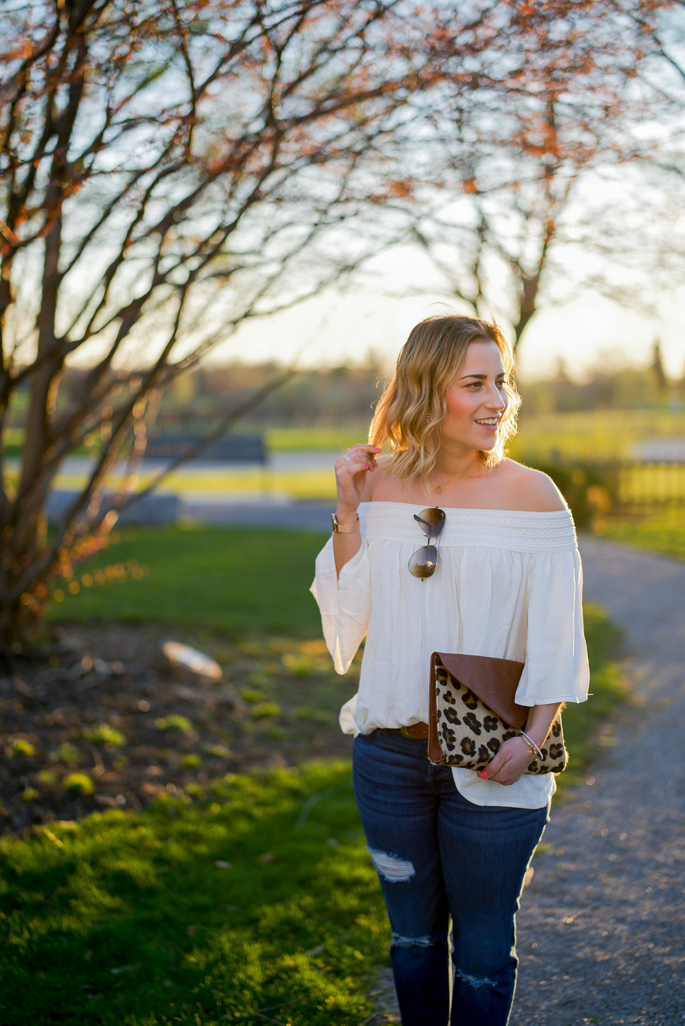 Canadian fashion blogger wearing a BB Dakota off the shoulder top with jeans as a simple spring outfit