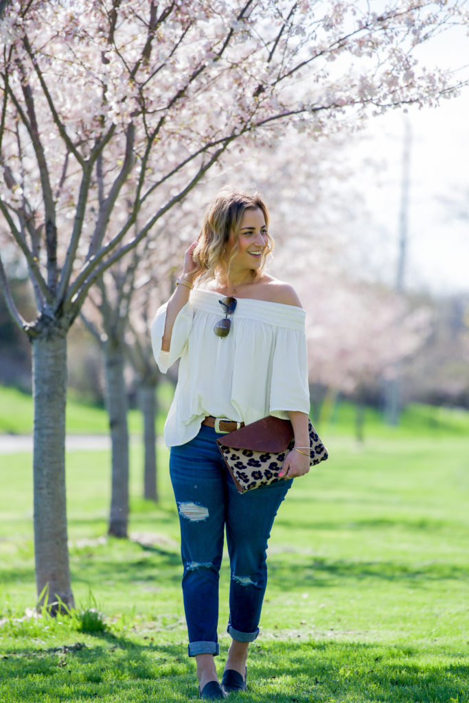 Canadian fashion blogger is wearing a BB Dakota off-the-shoulder top with boyfriend jeans for a spring outfit