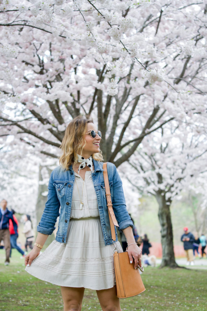 One of the simplest outfits to wear for spring and summer is a dress with a jean jacket and that's what Toronto fashion blogger, Jackie of Something About That is wearing
