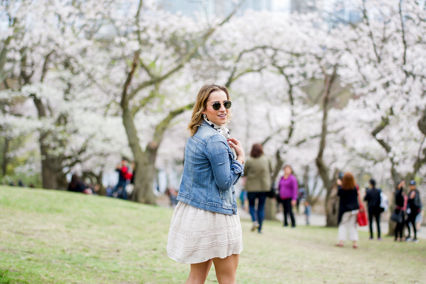 Simple outfit idea of a jean jacket with a dress, which is what Toronto lifestyle blogger, Jackie of something about that wore to see the cherry blossoms at high park