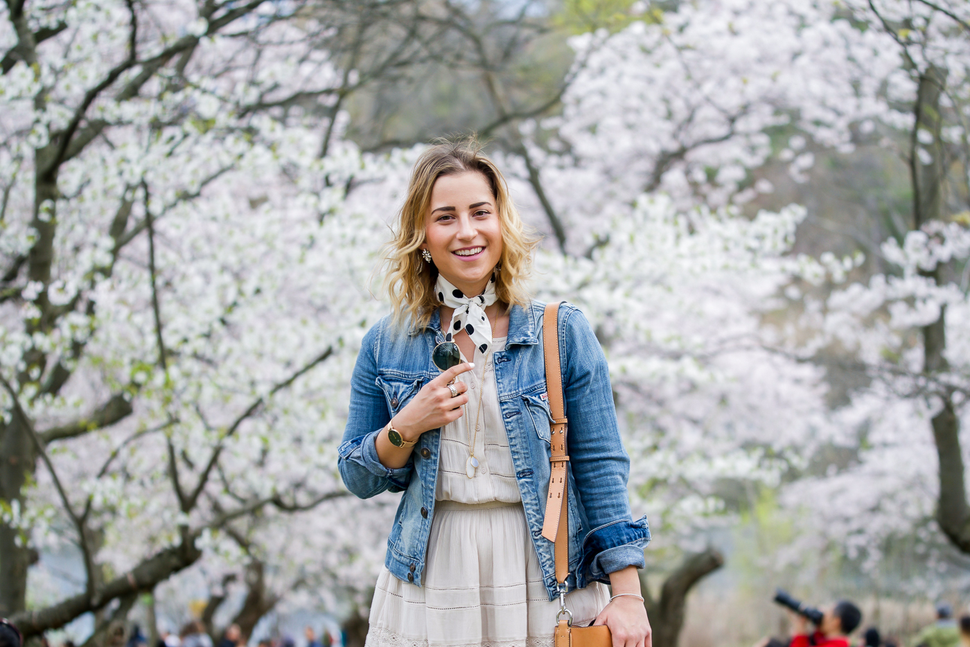 Canadian fashion and lifestyle blogger, Jackie of Something About That, wearing a denim jacket over a simple dress from Aritzia