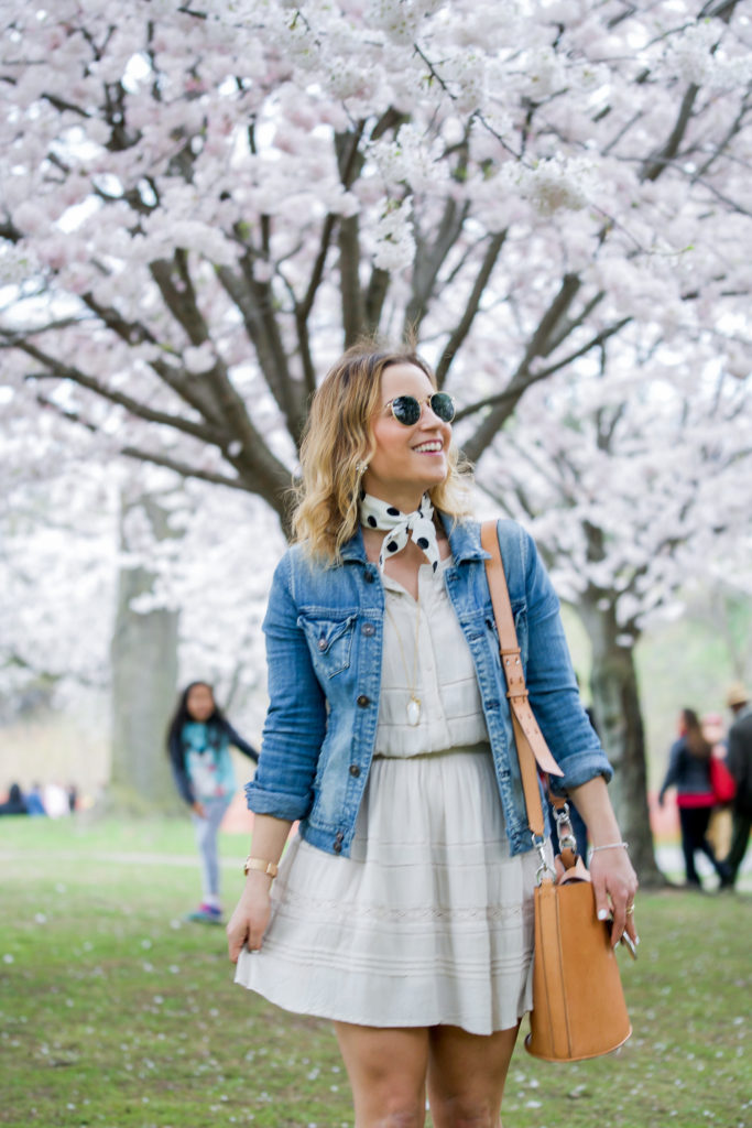Toronto-based lifestyle and fashion blogger, Jackie Goldhar of Something About That, is wearing a casual spring outfit at High Park to enjoy the cherry blossoms at their peak