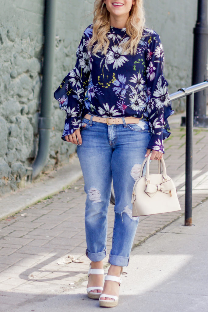 Jackie is a Toronto-based lifestyle blogger, who's wearing a chic weekend outfit with a Chicwish floral blouse and ripped boyfriend jeans