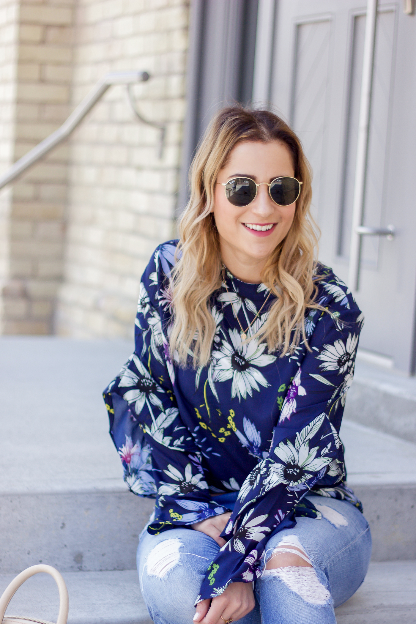 Chic weekend outfit idea, with a navy floral print blouse from Chicwish, and round Ray-Ban sunglasses, worn by lifestyle blogger Jackie Goldhar from Toronto, Canada