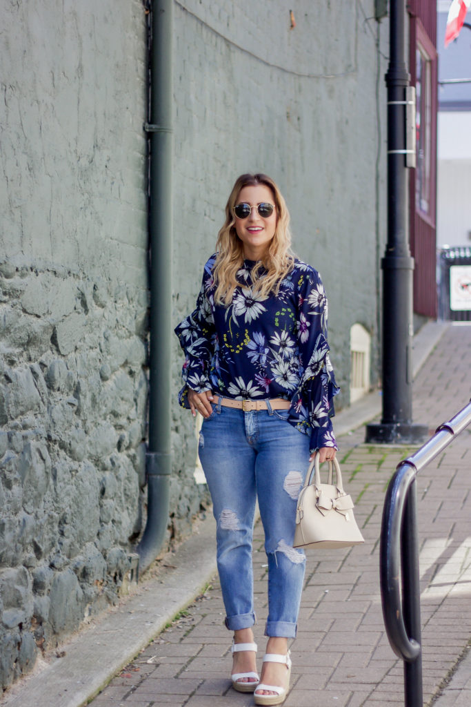 Spring outfit idea, with a navy floral top from Chicwish, Seven For All Mankind Ripped Josefina boyfriend jeans