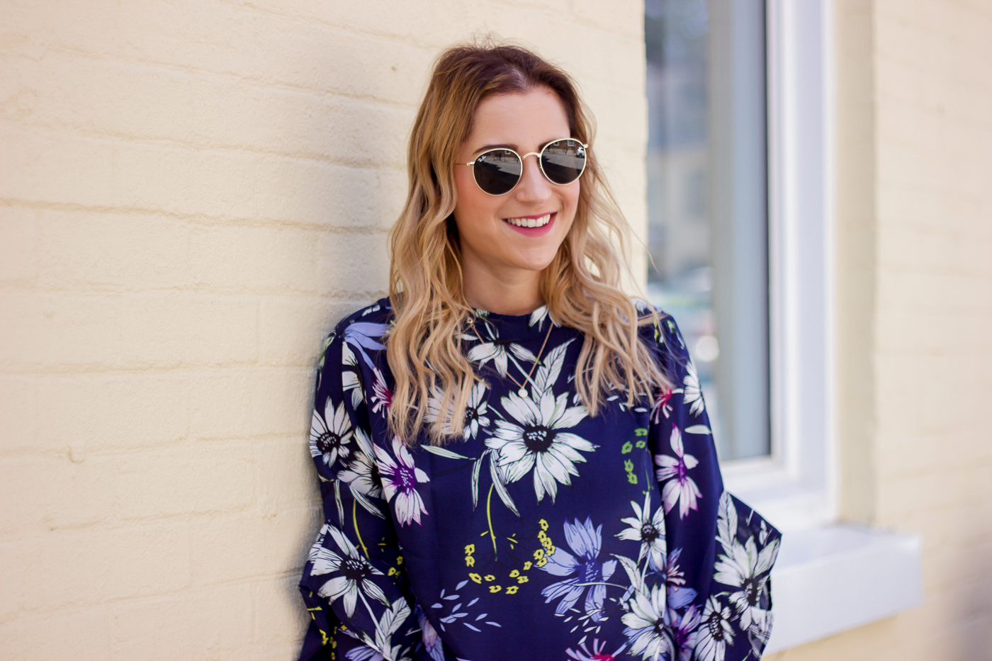 Jackie Goldhar is a Toronto-based fashion and lifestyle blogger, wearing a navy floral top from Chicwish