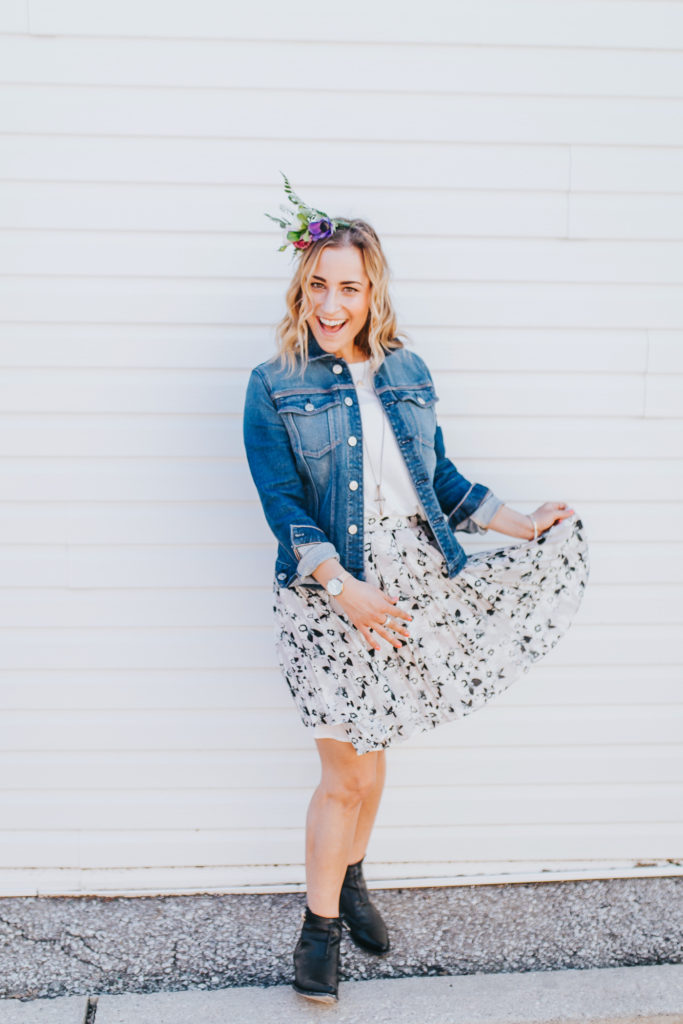 Canadian fashion and lifestyle blogger, Jackie of Something About That is is wearing a denim jacket with a pretty floral skirt from Banana Republic and accessorized with a DIY flower crown