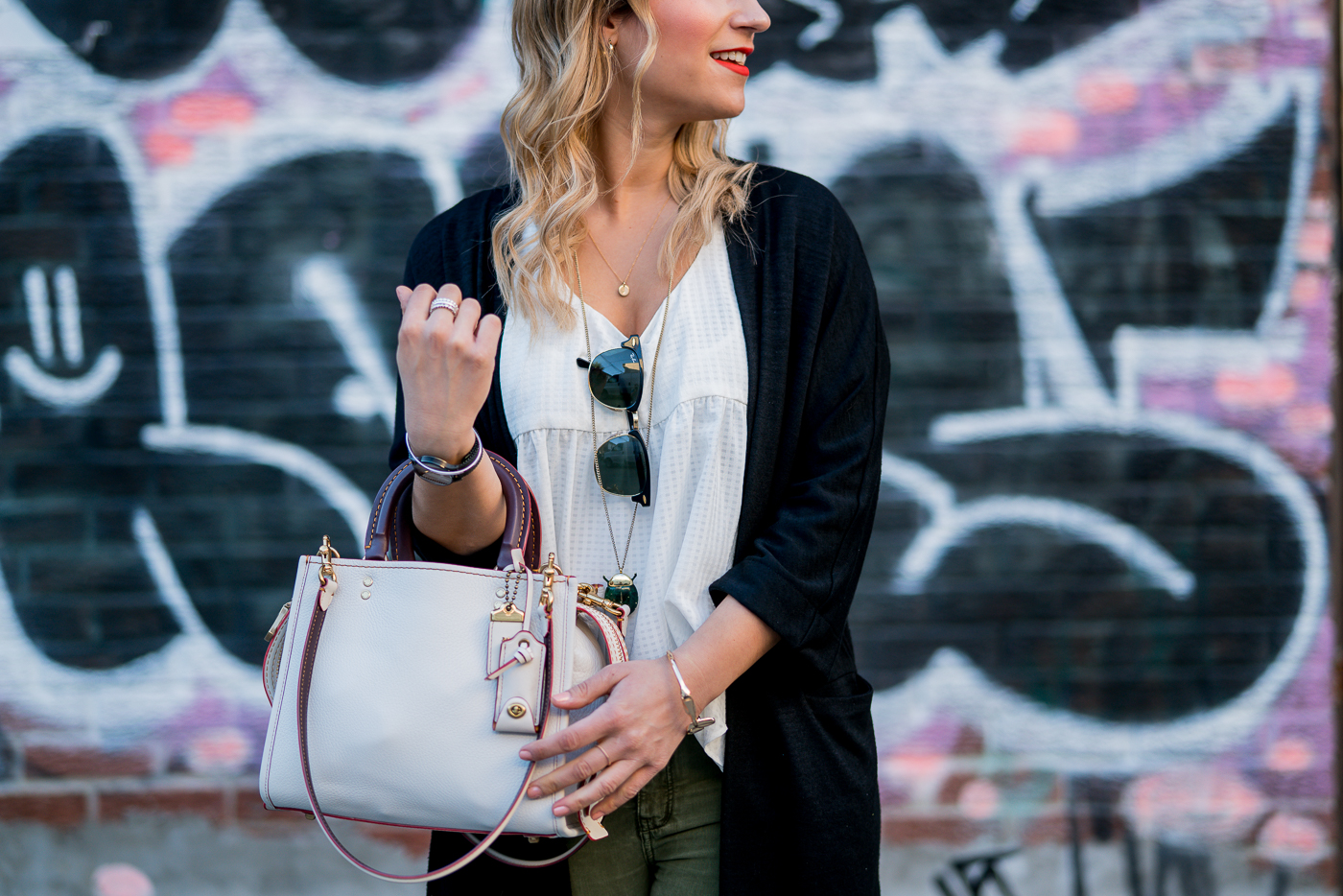 Canadian fashion blogger is wearing the Coach Rogue bag for spring