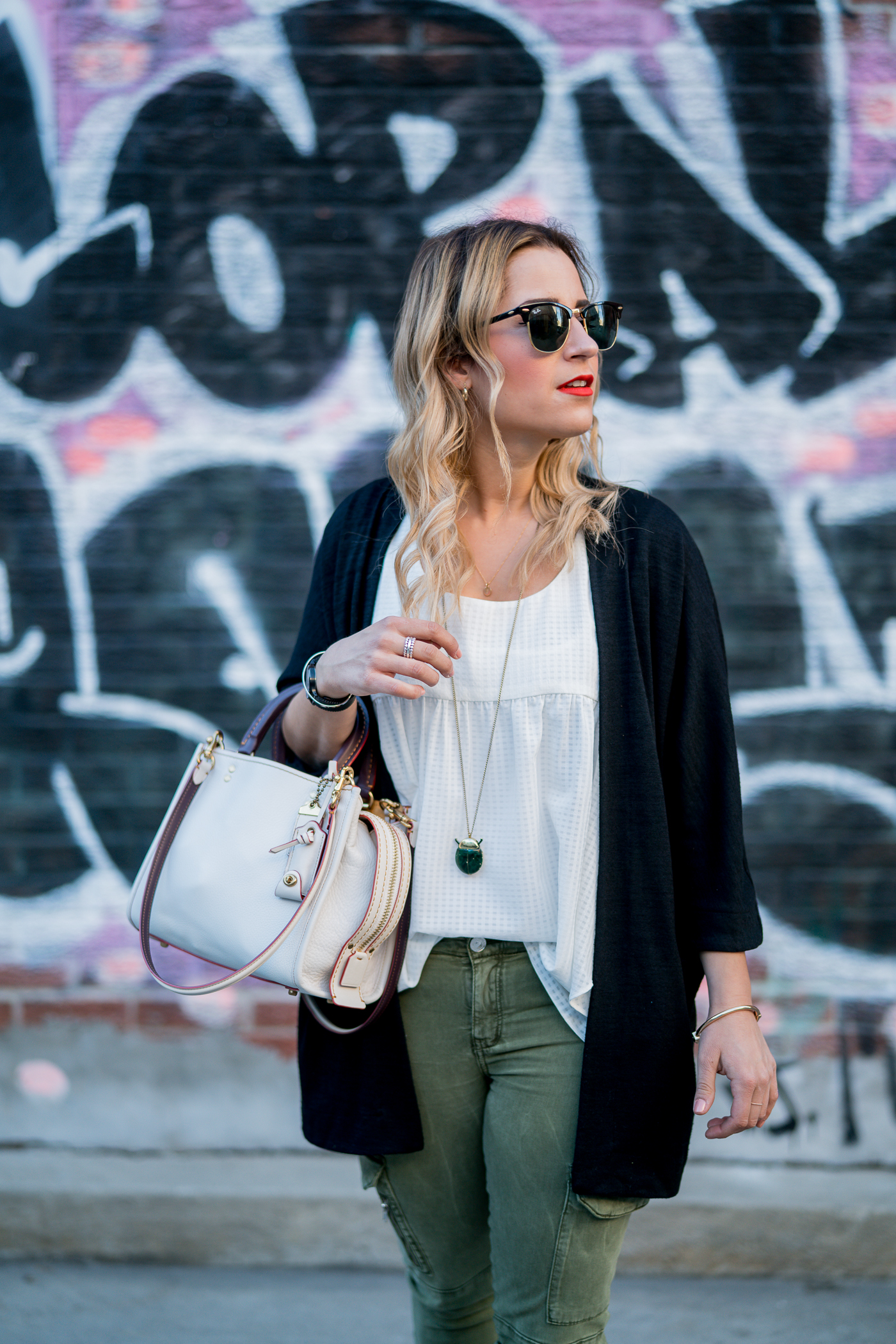 Toronto fashion and lifestyle blogger, Jackie of Something About That Blog, wearing the Zlata cardigan from Aritzia with a Coach Rogue Bag