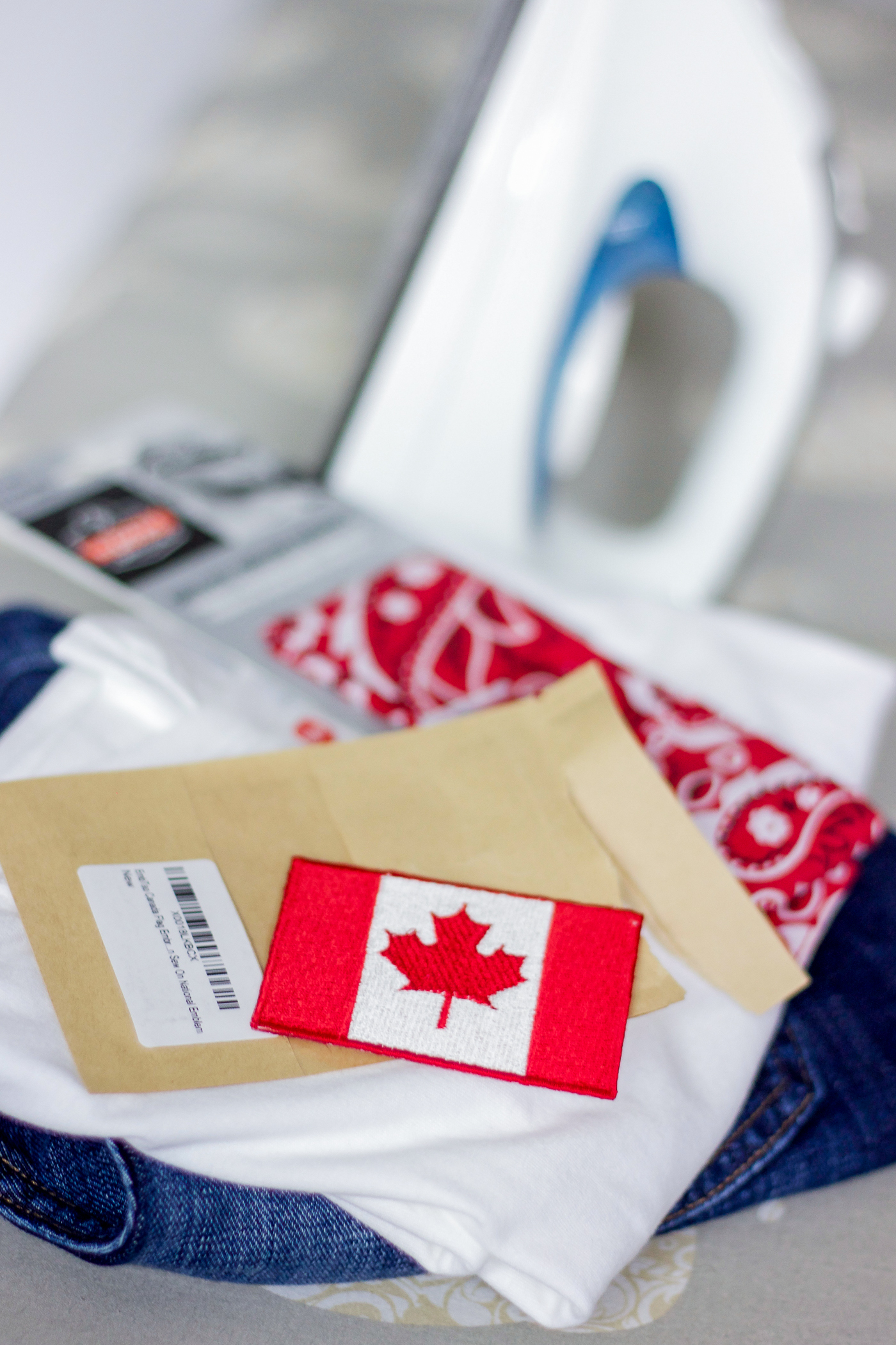 Easy DIY Canada Day outfit with a Hane's White t-shirt and Canadian flag iron-on embroidered patch from Amazon