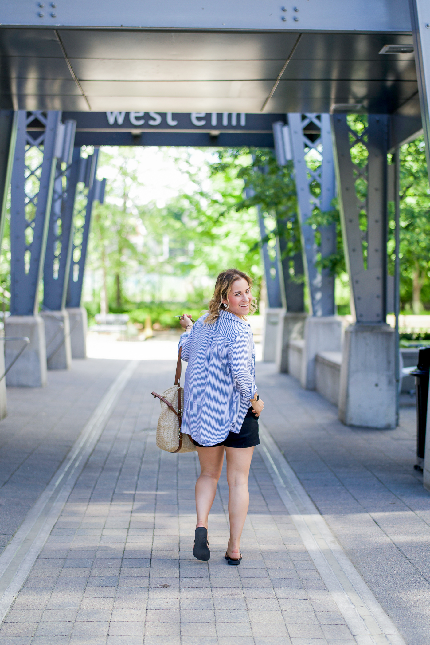 Summer outfit inspiration on a petite fashion blogger - a striped long sleeve button down worn open, black dress shorts from Banana Republic