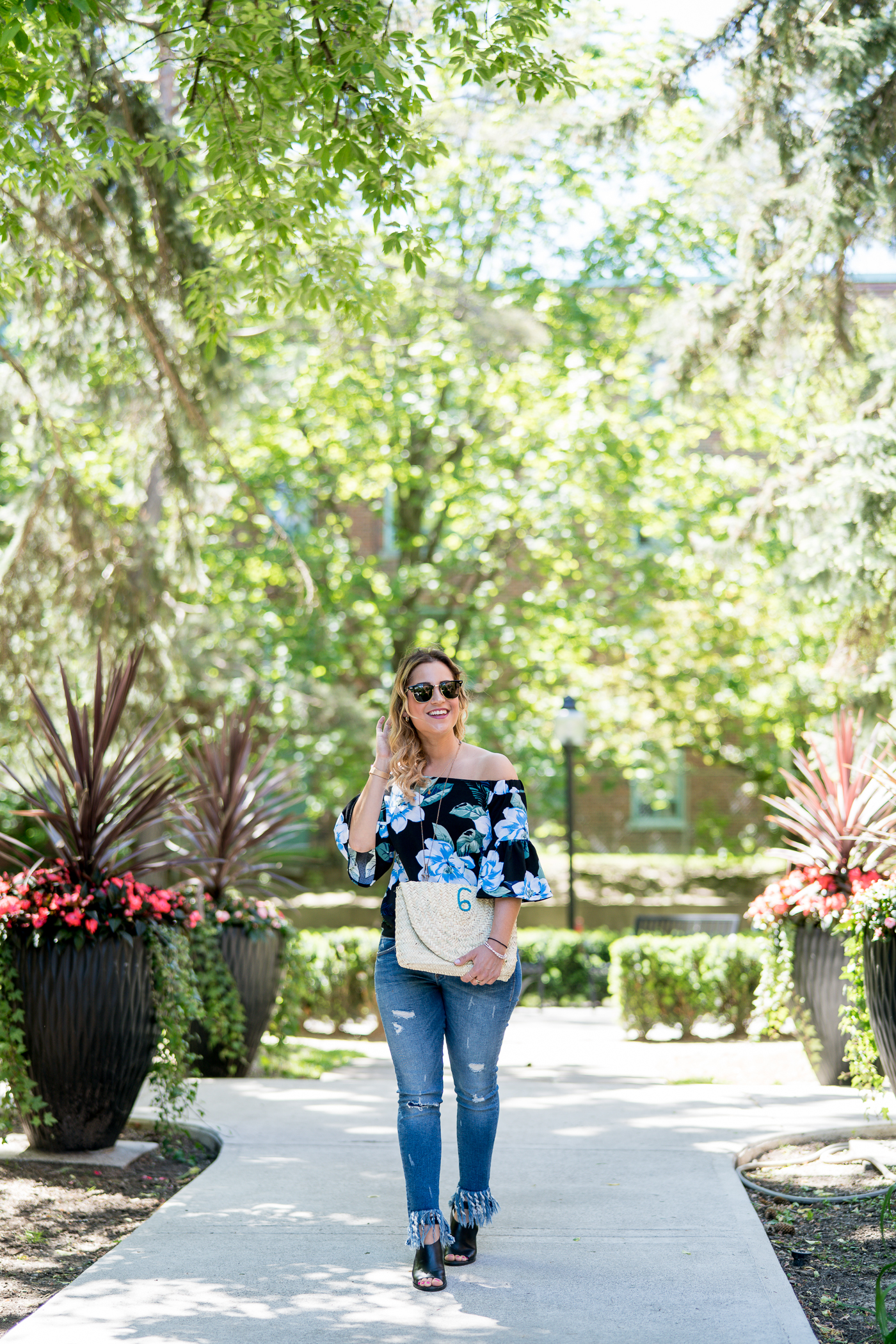 Canadian petite fashion blogger, Jackie at Something About That, wearing a floral OTS top from Banana Republic with frayed hem jeans from Zara
