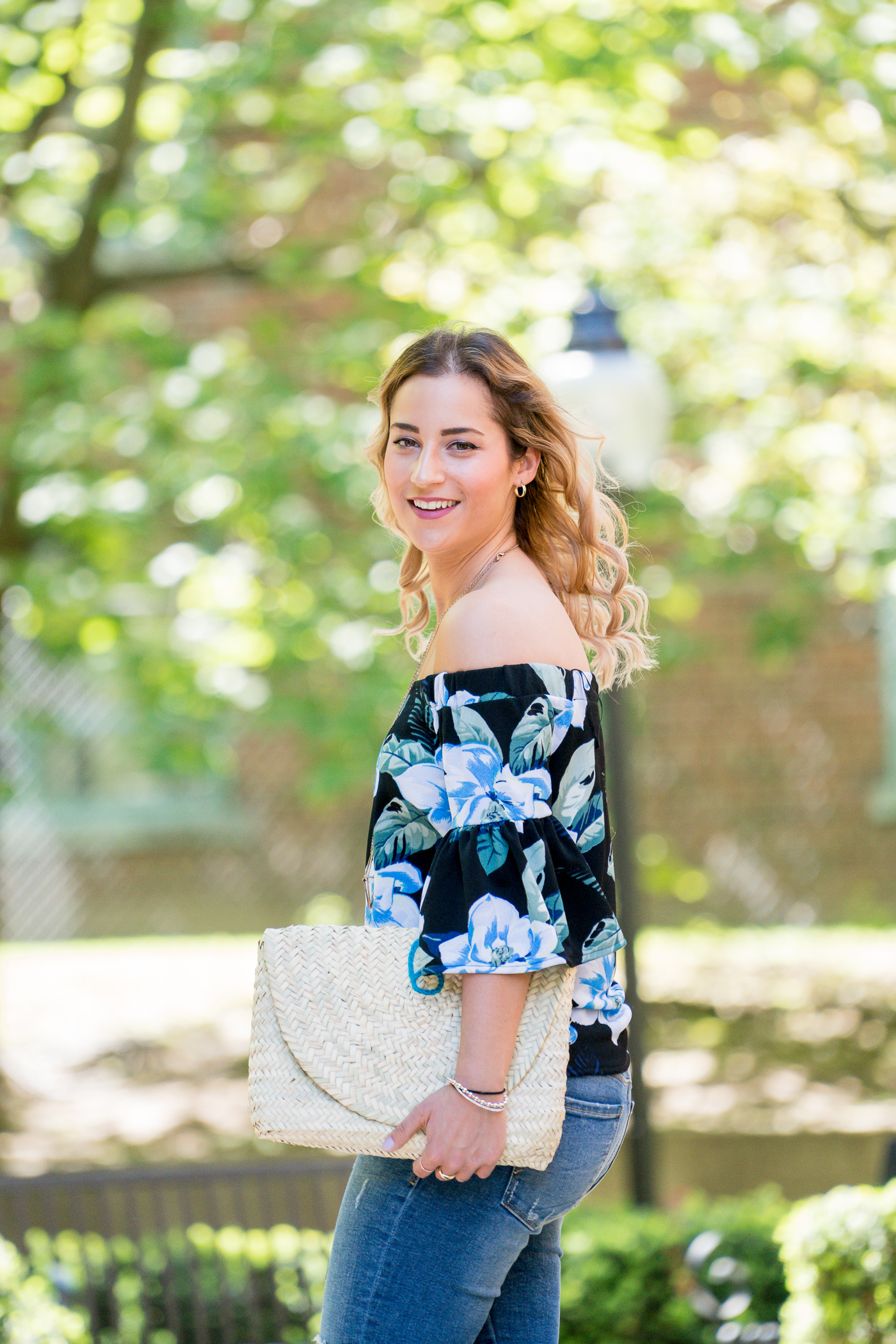Canadian lifestyle and fashion blogger, Jackie Goldhar at Something About That, wearing an OTS floral print top from Banana Republic