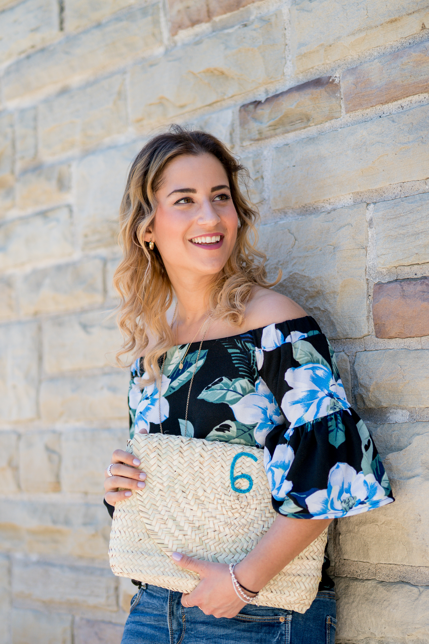 toronto lifestyle and fashion blogger, Jackie at Something About That, wearing a l'enveloppe clutch from tuck shop trading co. and poolside bags collection