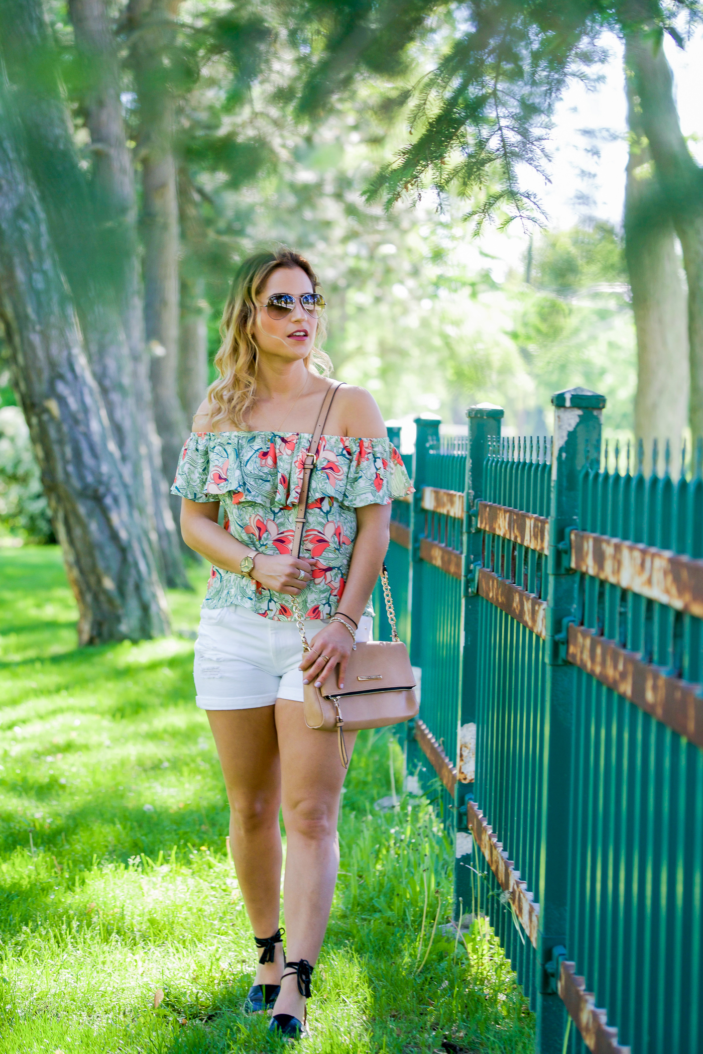 Summer outfit from GUESS with a printed off the shoulder top and white shorts
