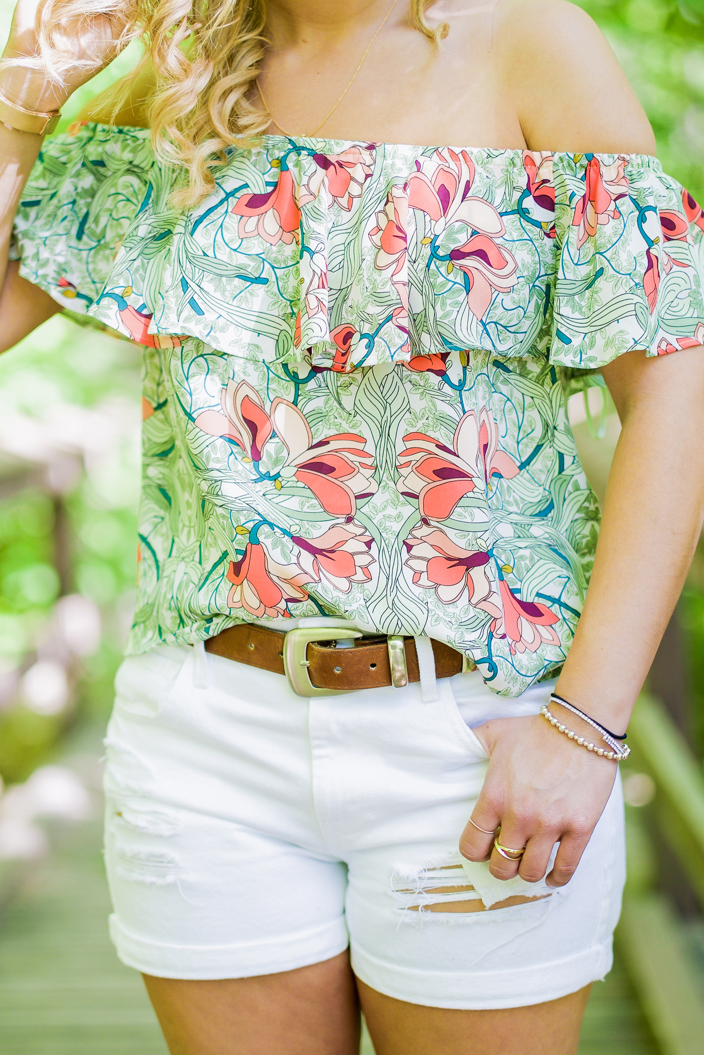floral printed ruffle off the shoulder top from GUESS, with white ripped boyfriend shorts
