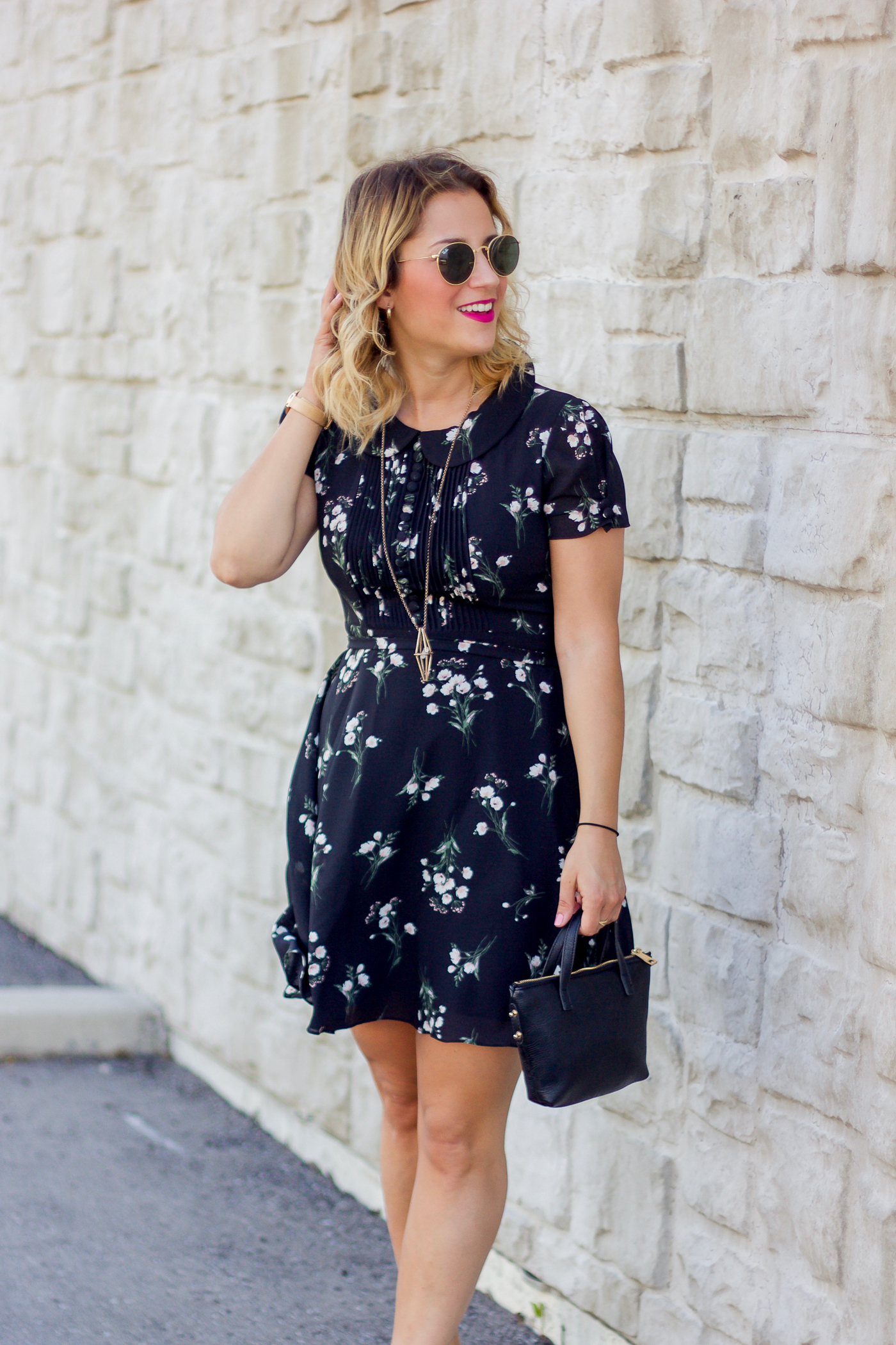 Toronto petite fashion and lifestyle blogger, Jackie at Something About That, wearing a Chicwish black floral print summer dress