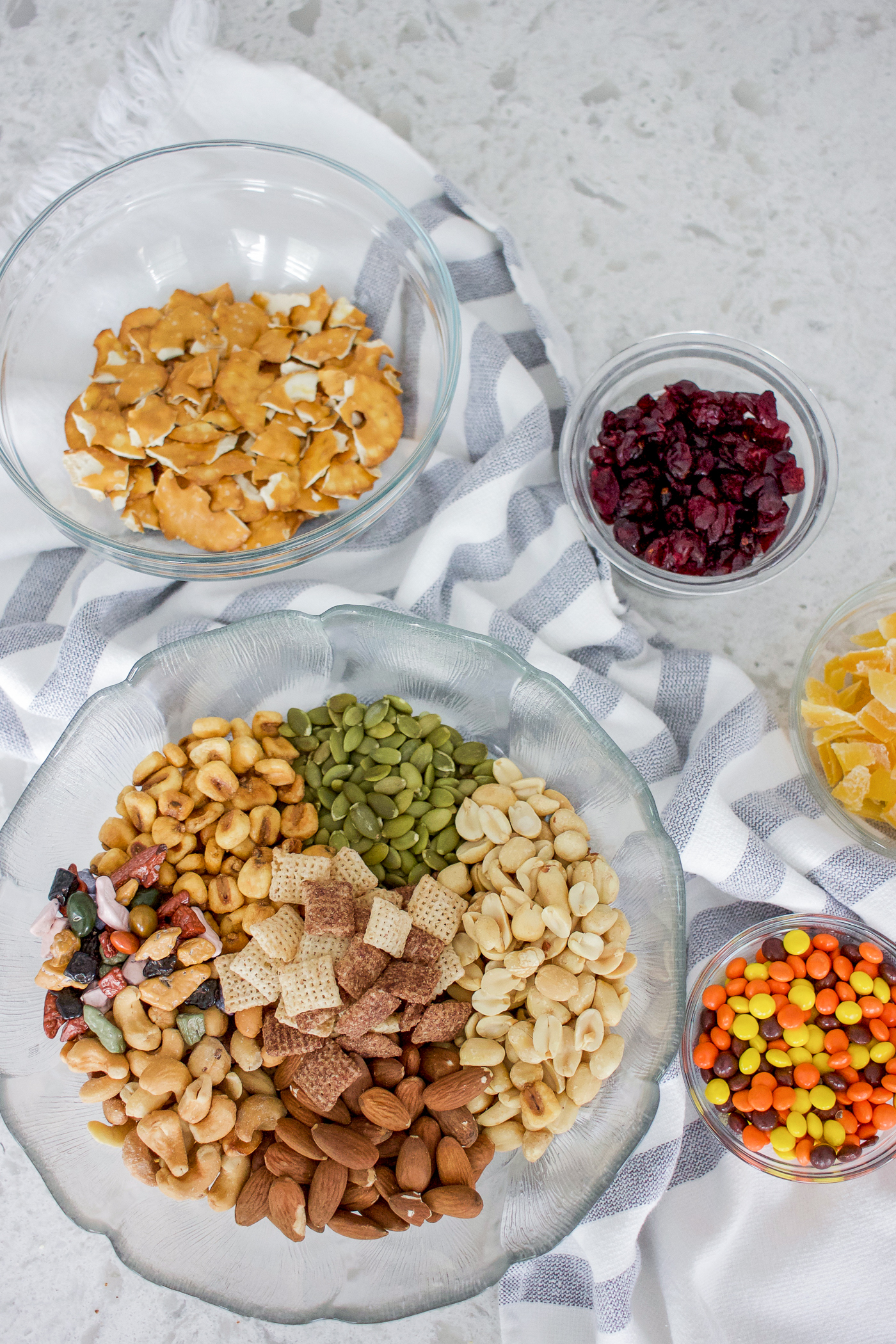 Simple trail mix recipe that has almonds, peanuts, pumpkin seeds, chocolate chex, corn nuts and more