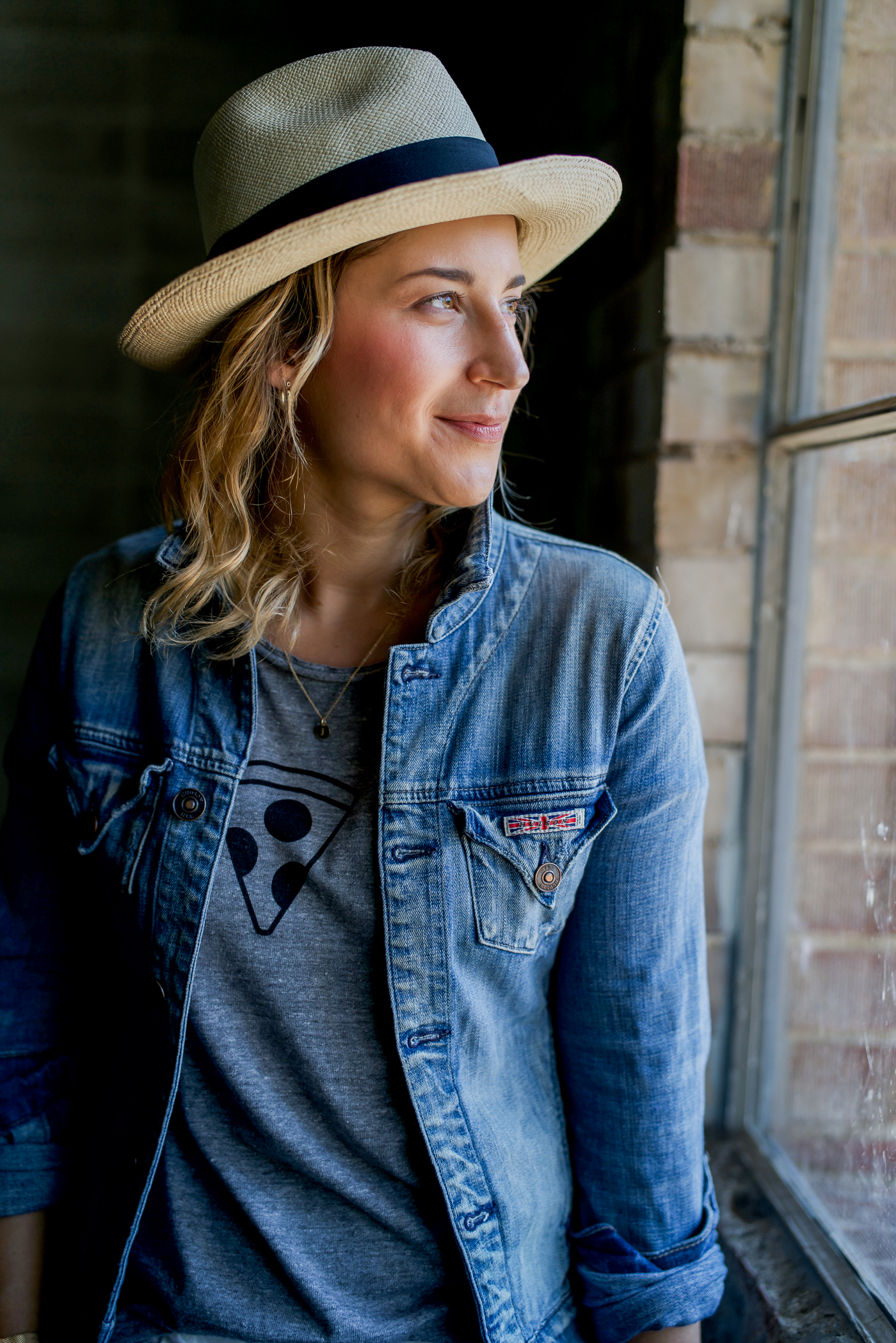 Toronto fashion and lifestyle blogger is wearing the Chaser Brand Daily Rituals Tee with a Hudson Jeans denim jacket and straw hat from Aritzia