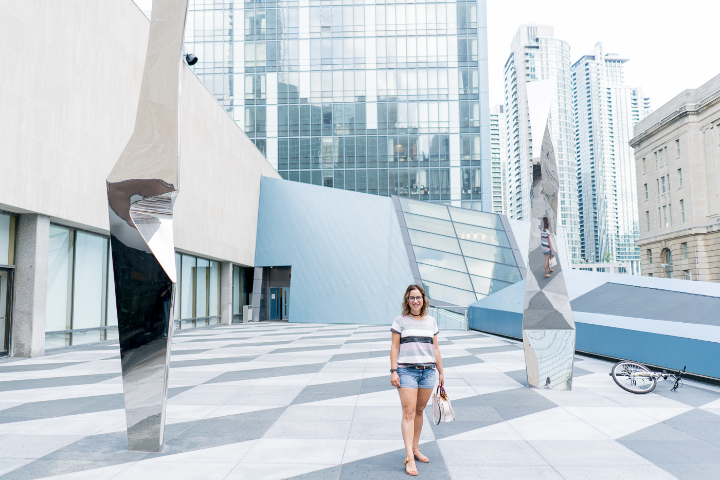 Toronto lifestyle and fashion blogger is wearing a Gap striped softspun t-shirt with denim shorts