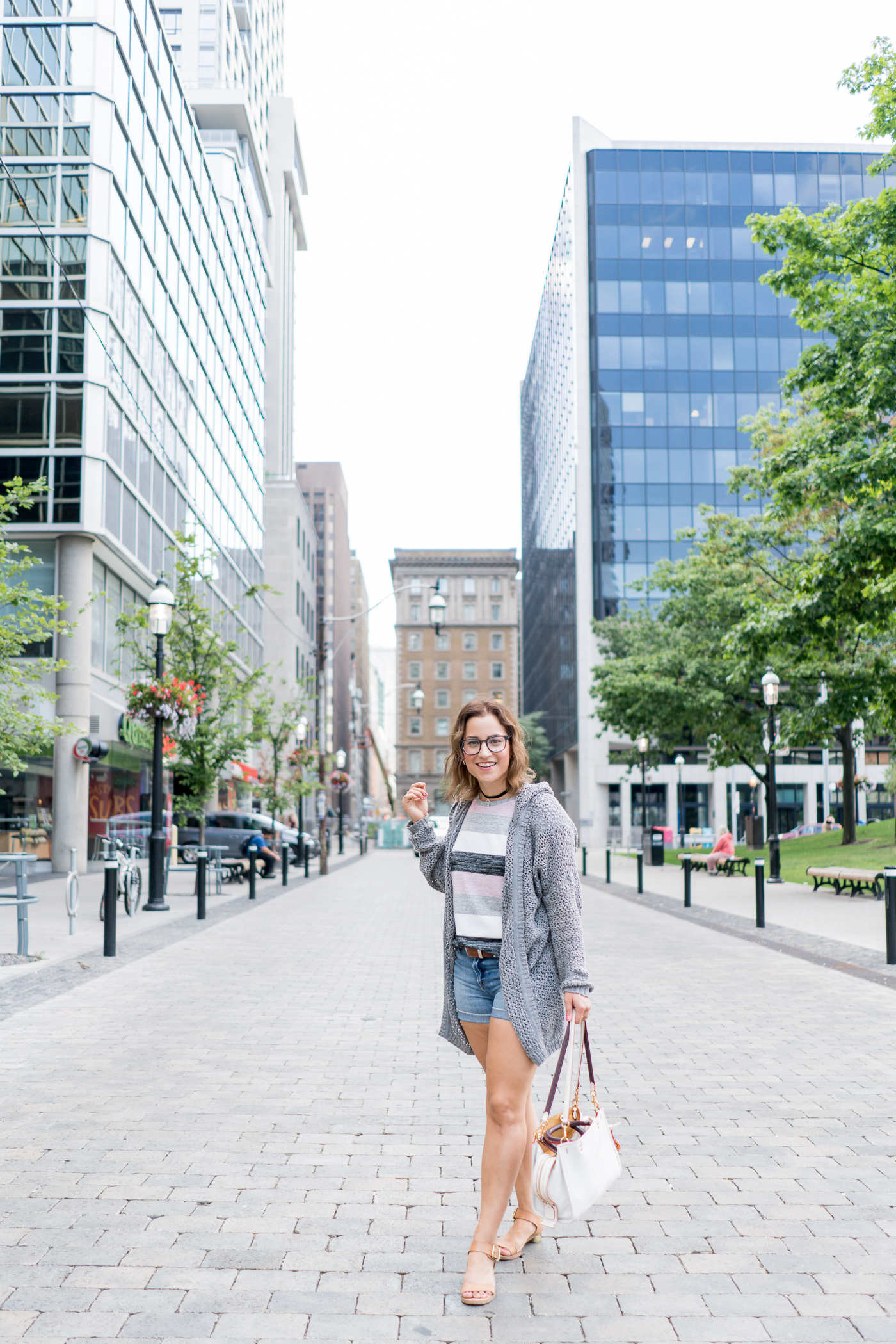 Effortless casual summer outfit, with a striped t-shirt, denim shorts from J.Crew factory and a lightweight cardigan from Artizia