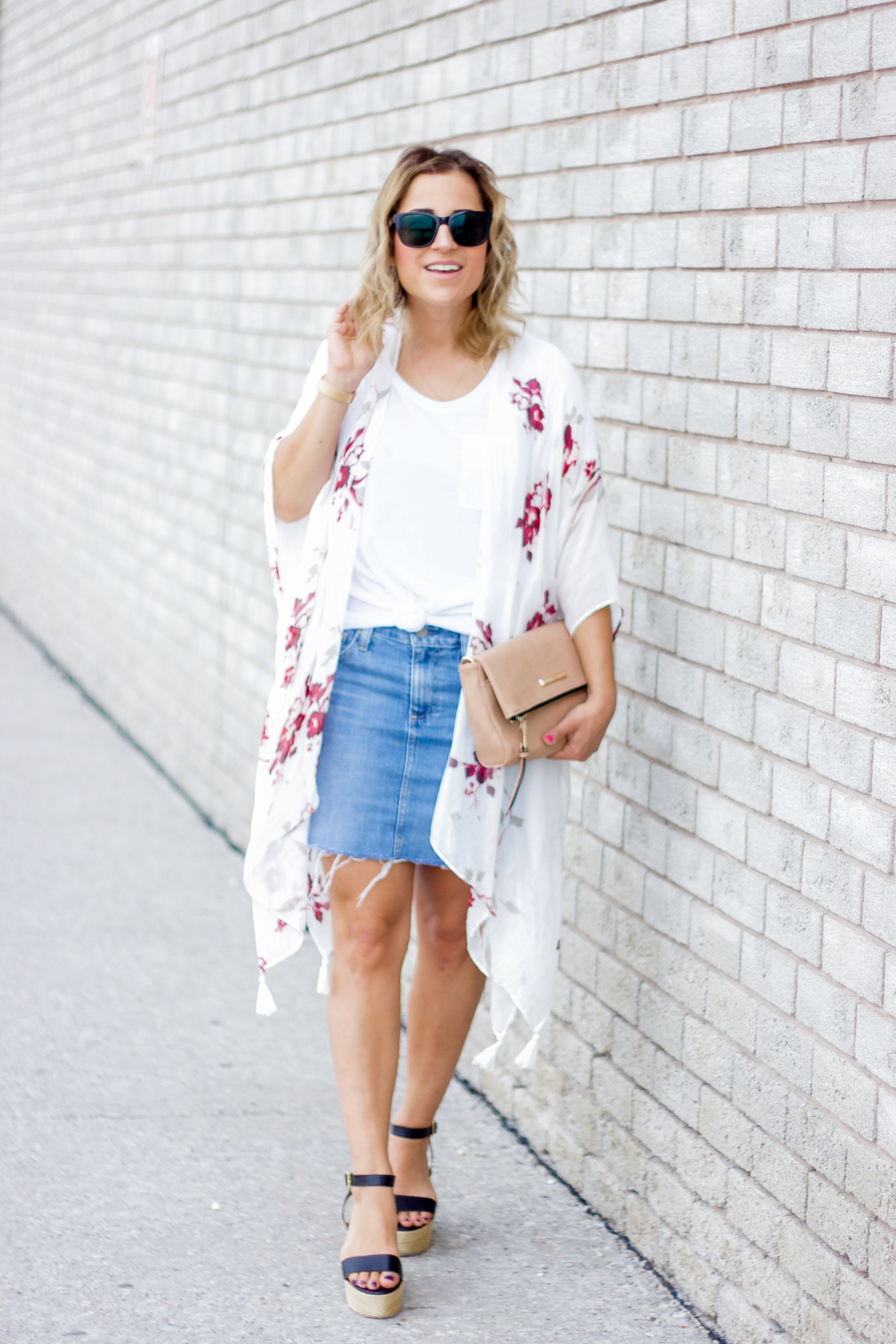 Petite-friendly summer outfit idea, with a denim skirt and white t-shirt