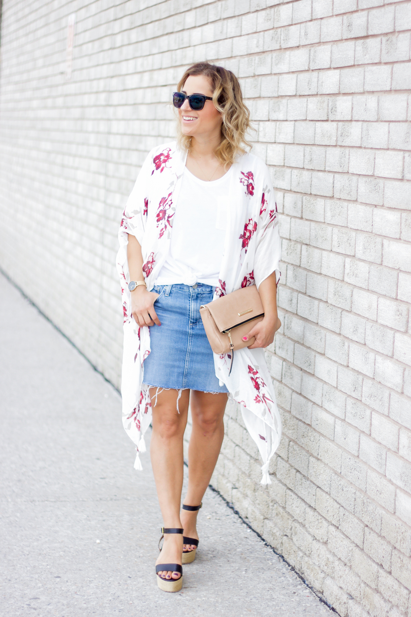 Summer outfit idea with a denim skirt and white t-shirt