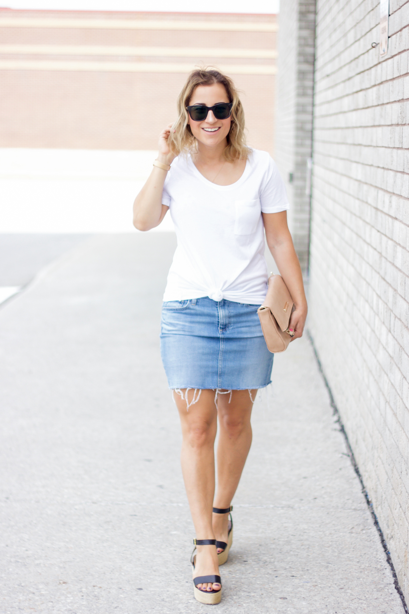 Simple summer outfit, wearing a white boyfriend t-shirt from Sears with an AG jeans denim skirt with an unfinished raw hem