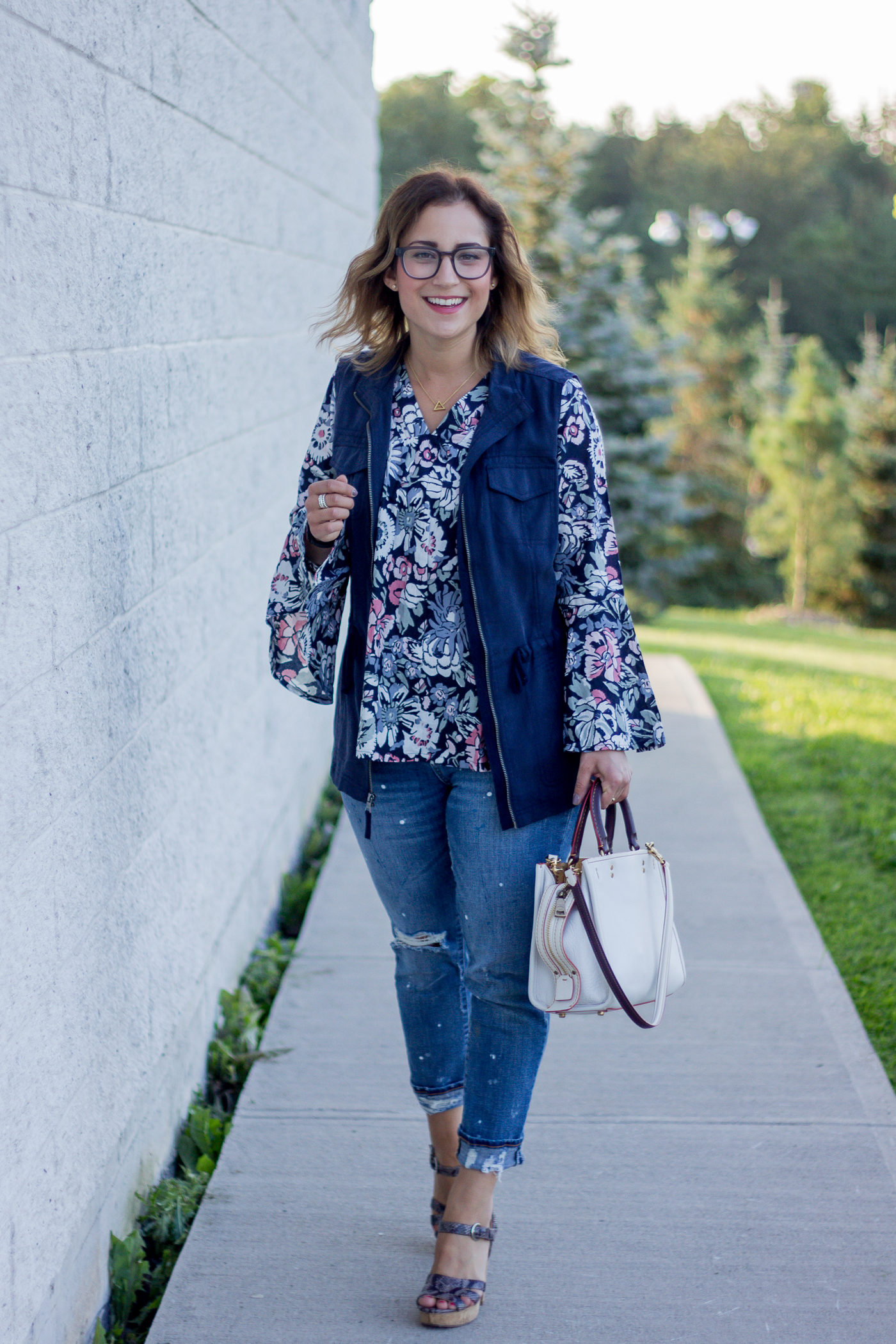 Dark floral top for fall with a navy cargo vest from Merona, with ripped girlfriend jeans from Gap