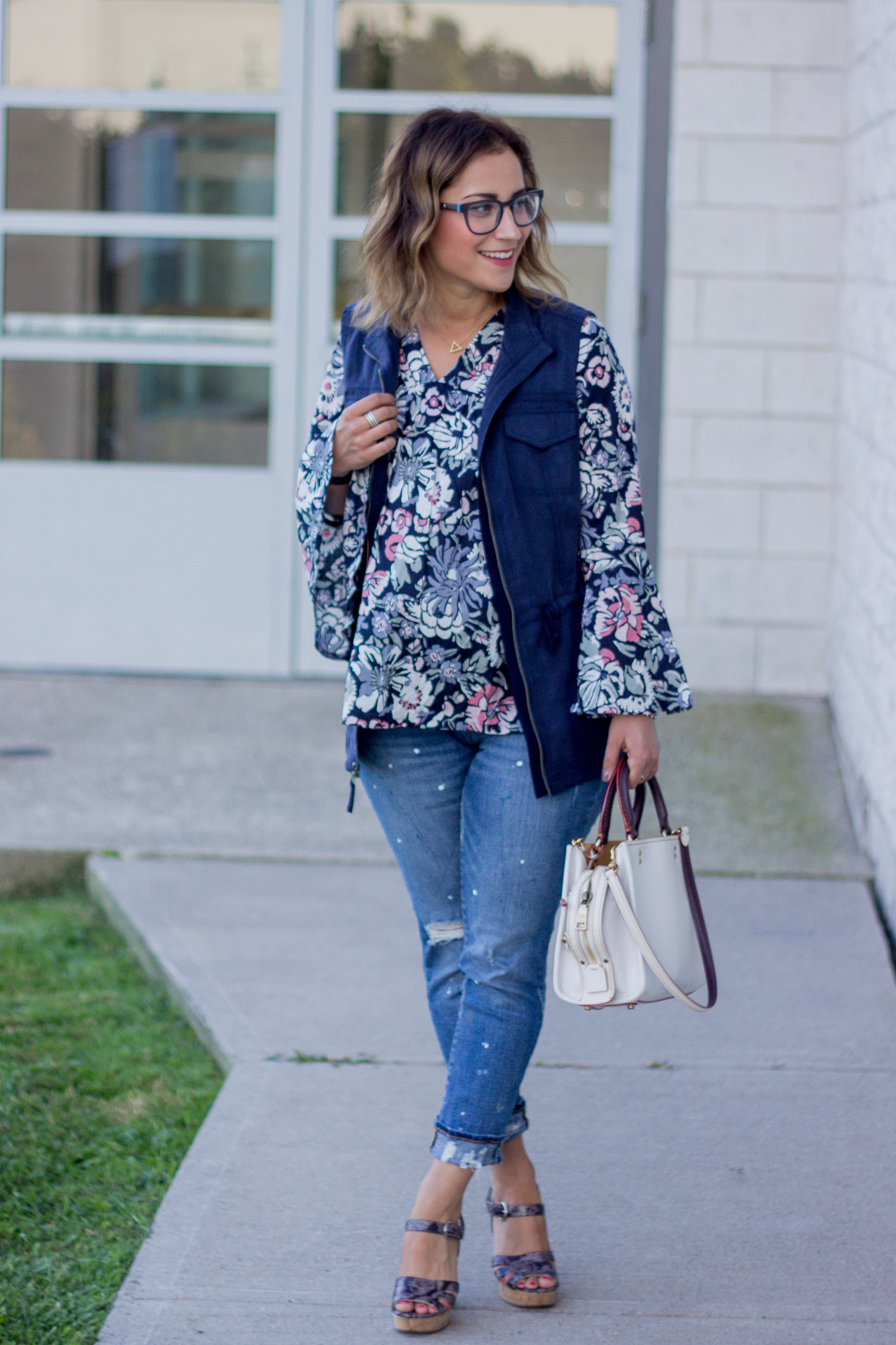 Toronto fashion blogger is wearing a floral bell sleeve top from Amazon, with a navy cargo vest from Target, with Gap jeans